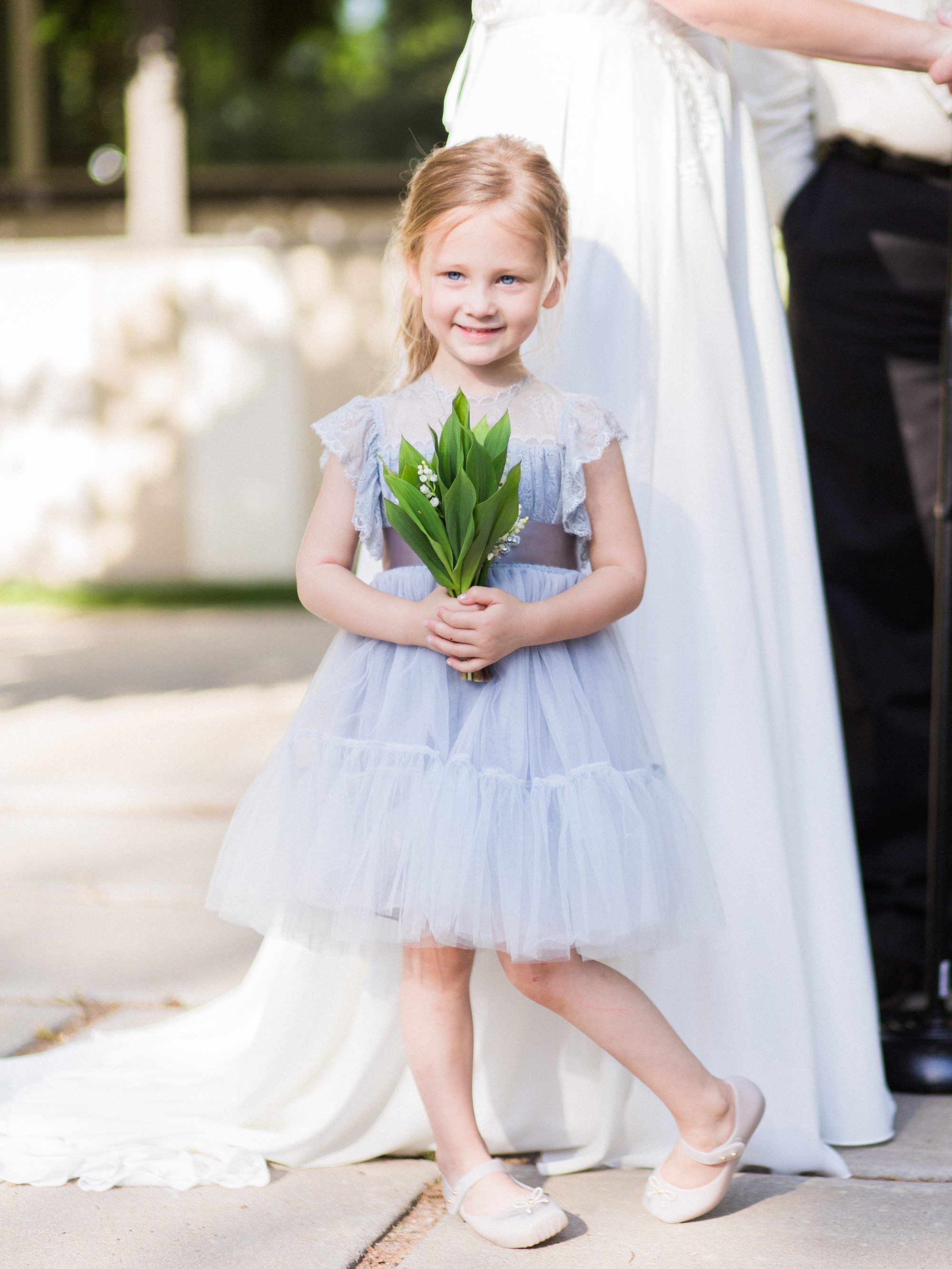 flower girl wearing light blue dress