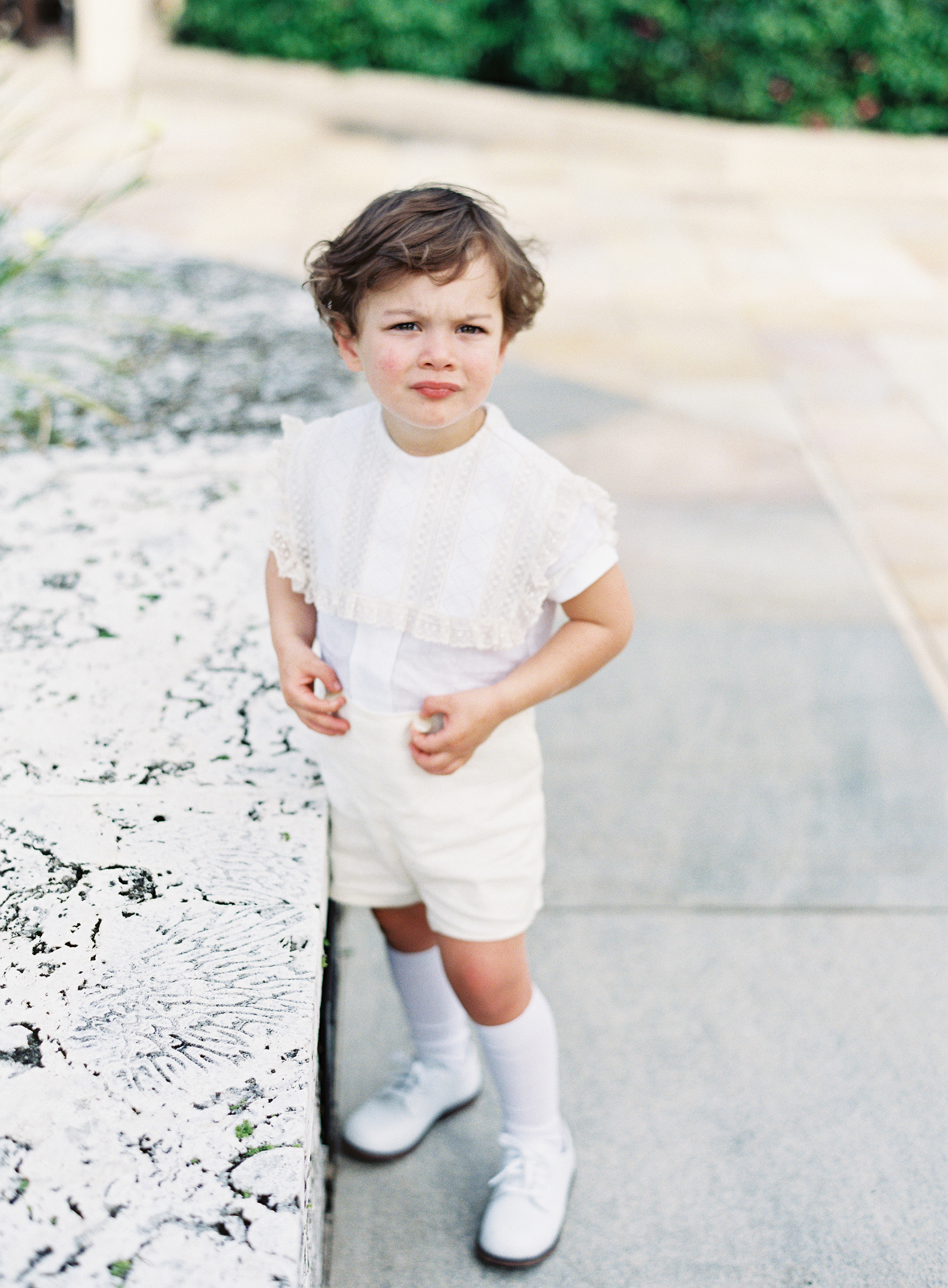 ring bearer wearing lace shirt with shorts