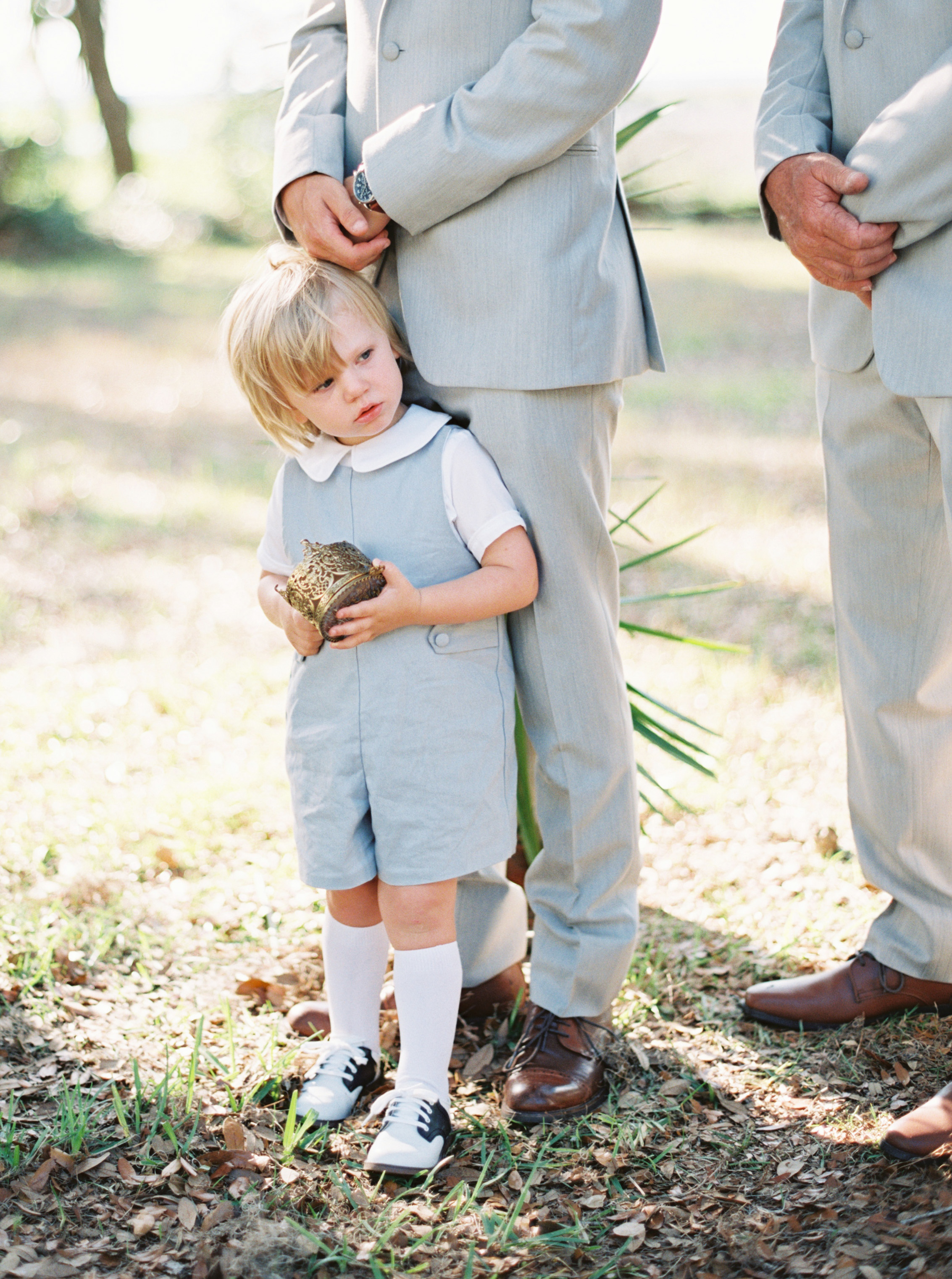 ring bearer in light blue overalls