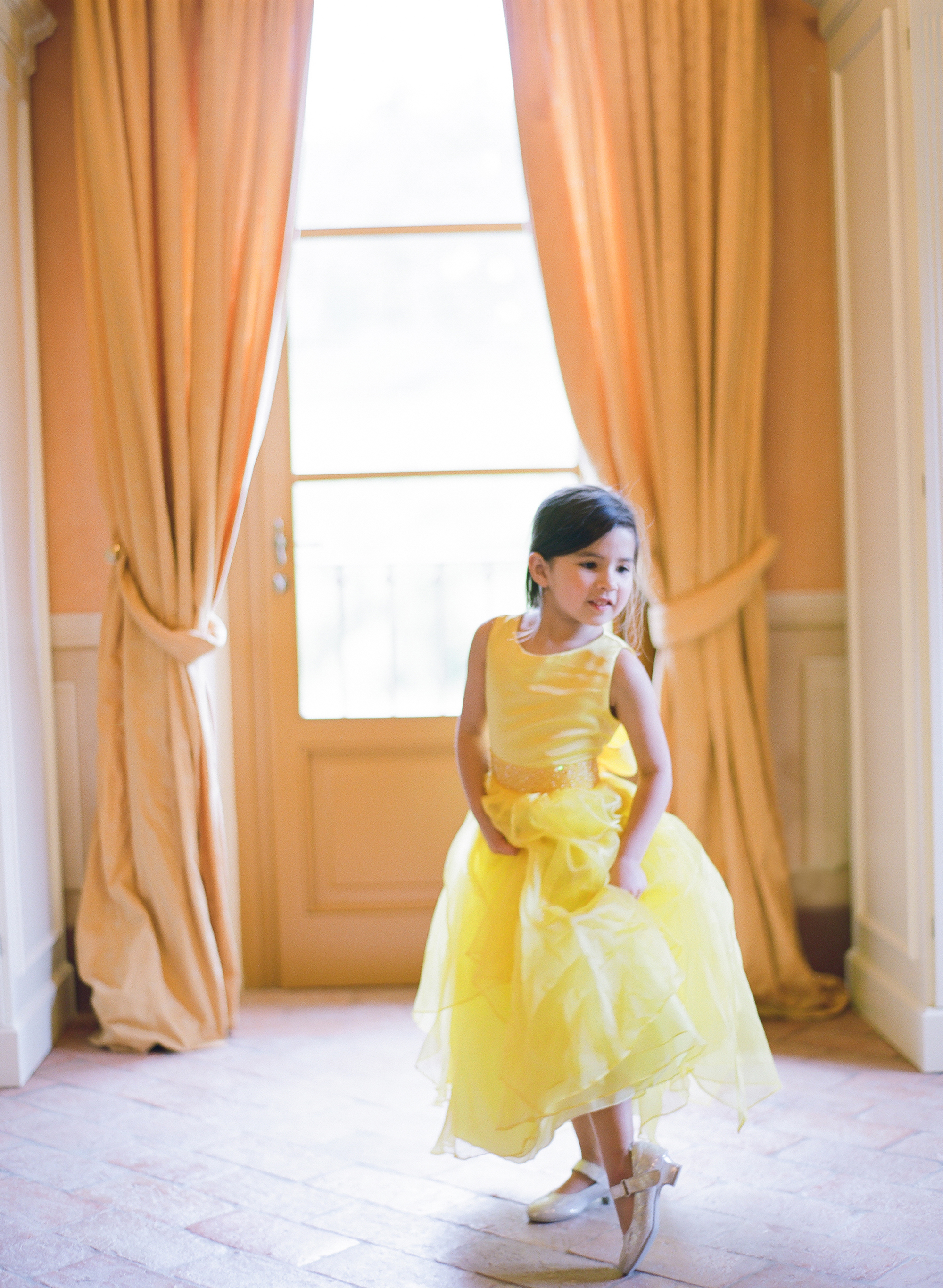 flower girl wearing yellow dress