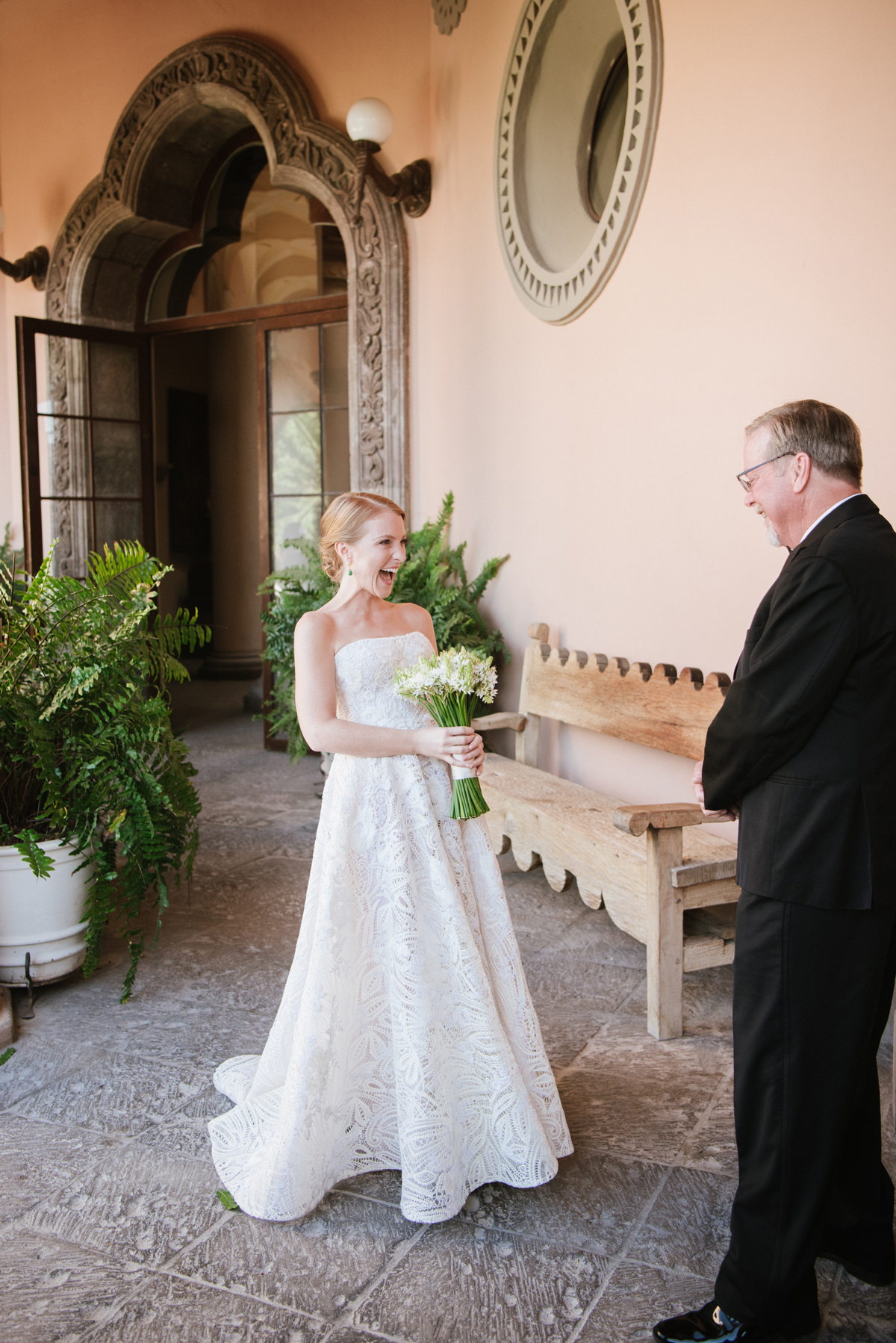 bride sharing first look with her father
