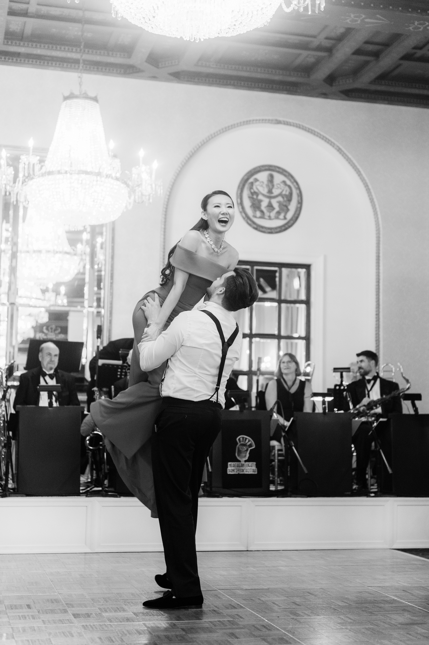 groom lifts bride during first dance