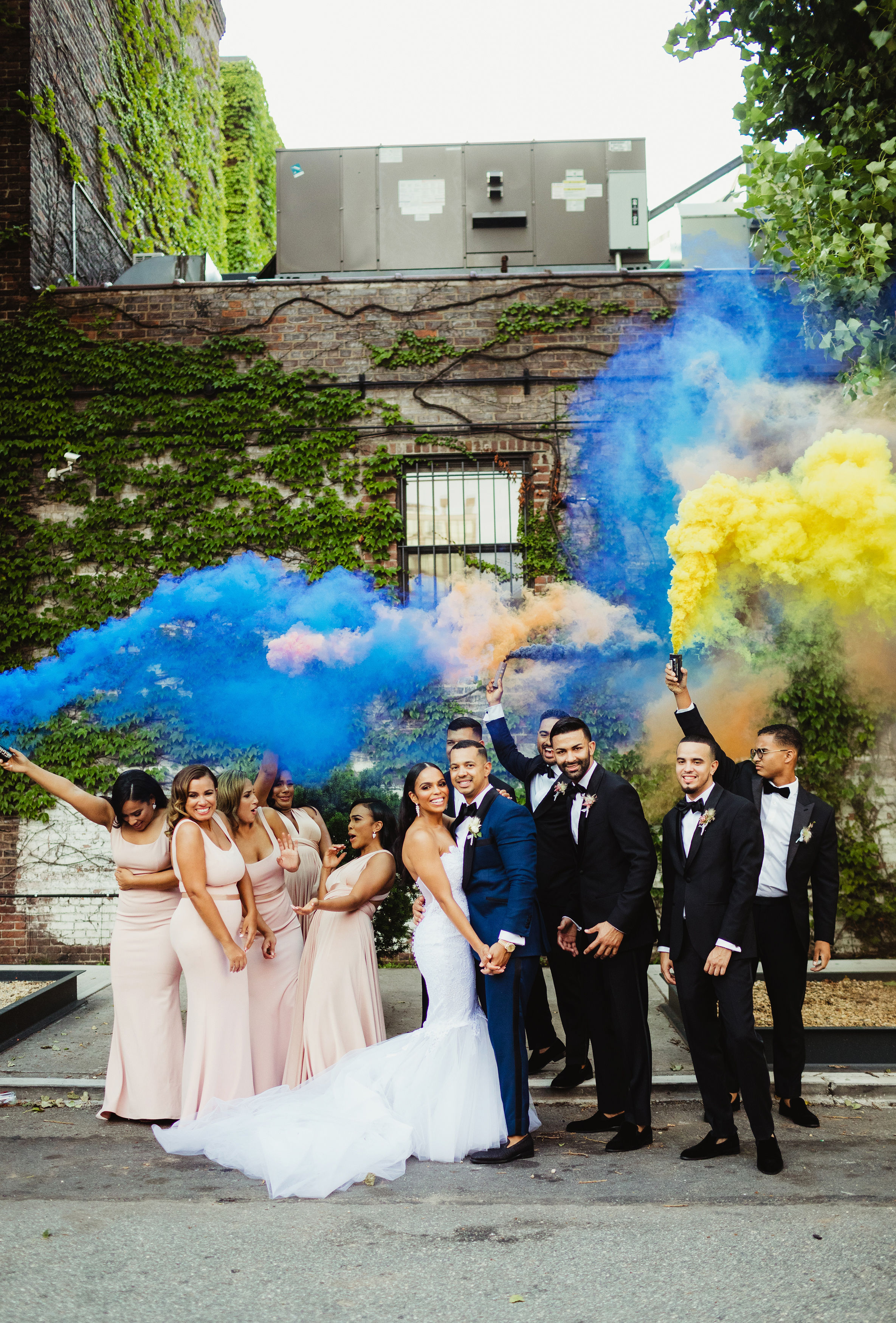 wedding party with blue and yellow smokebomb