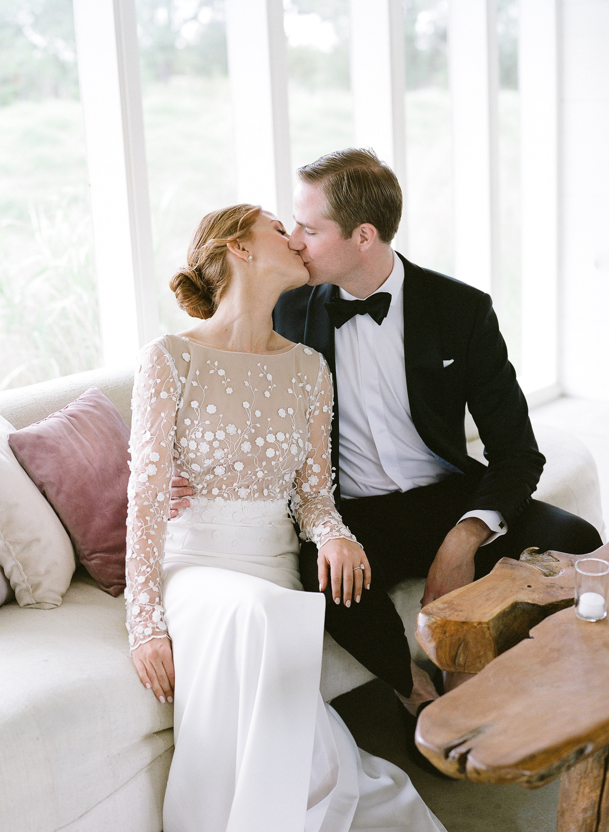 brittany peter wedding couple kissing on couch
