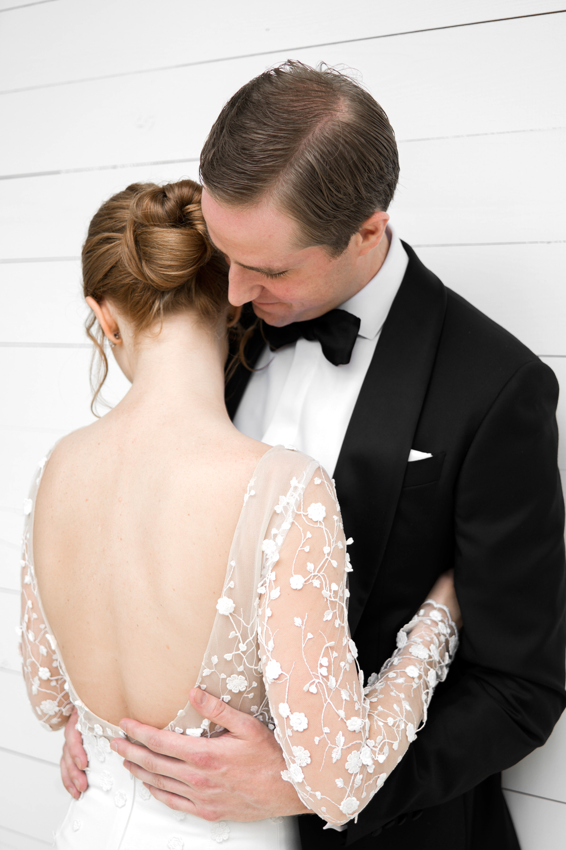 brittany peter wedding couple hugging bride backless dress