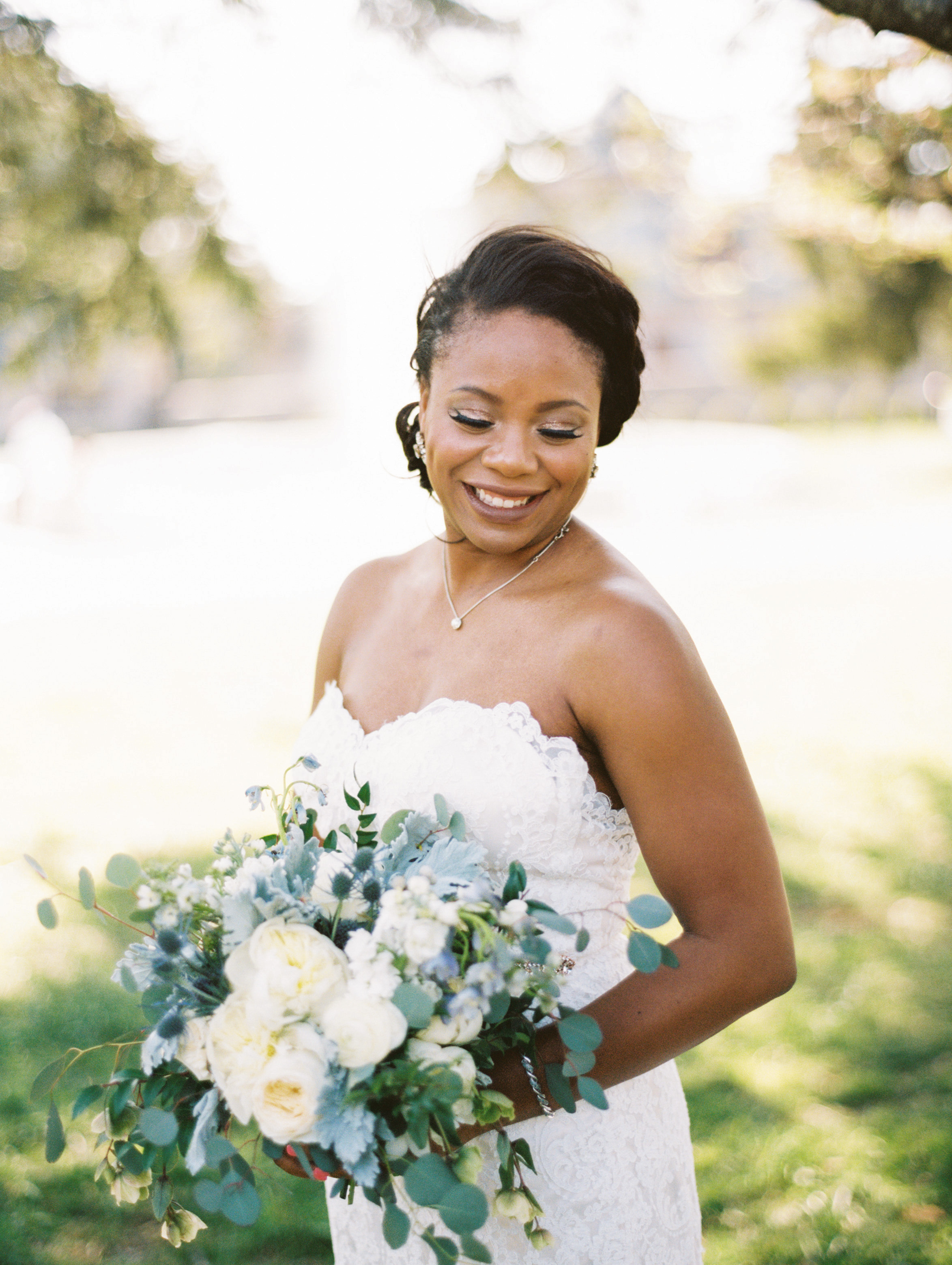 wedding bride holding bouquet white blue flowers