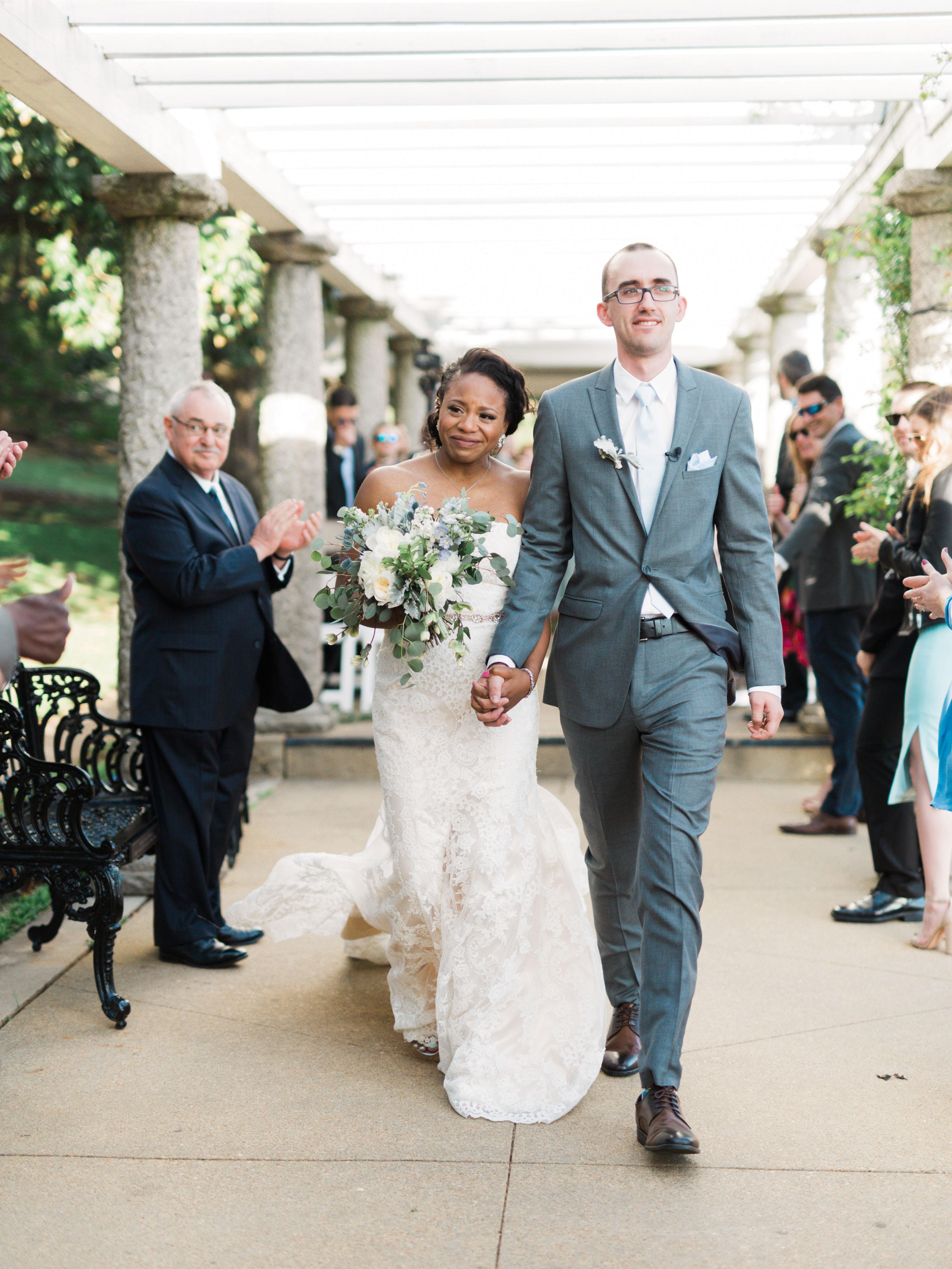 wedding recessional bride groom walk holding hands