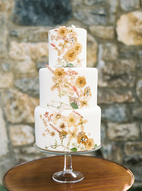 golden pressed flower wedding cake