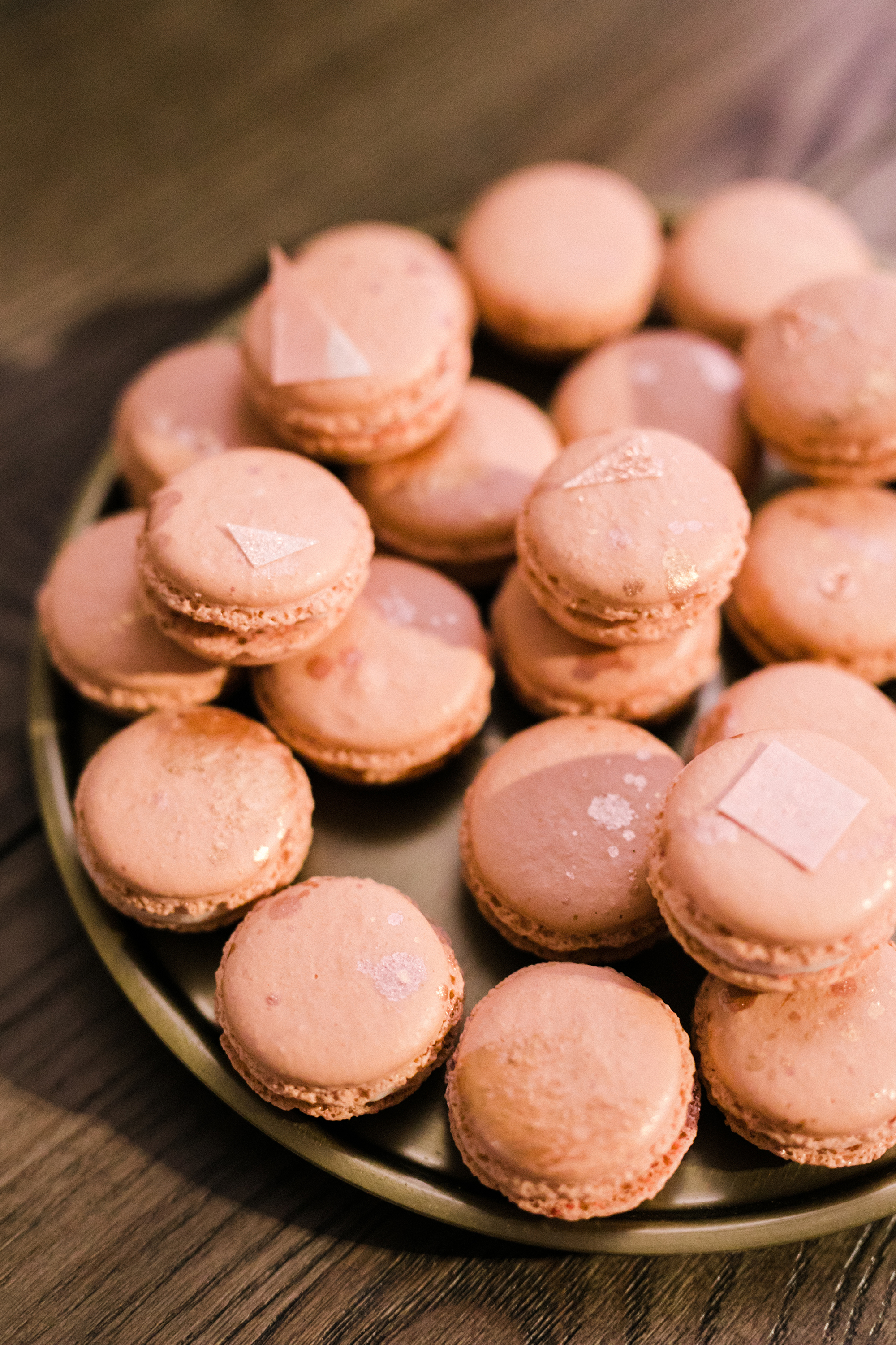 pink macarons with rose gold splatter