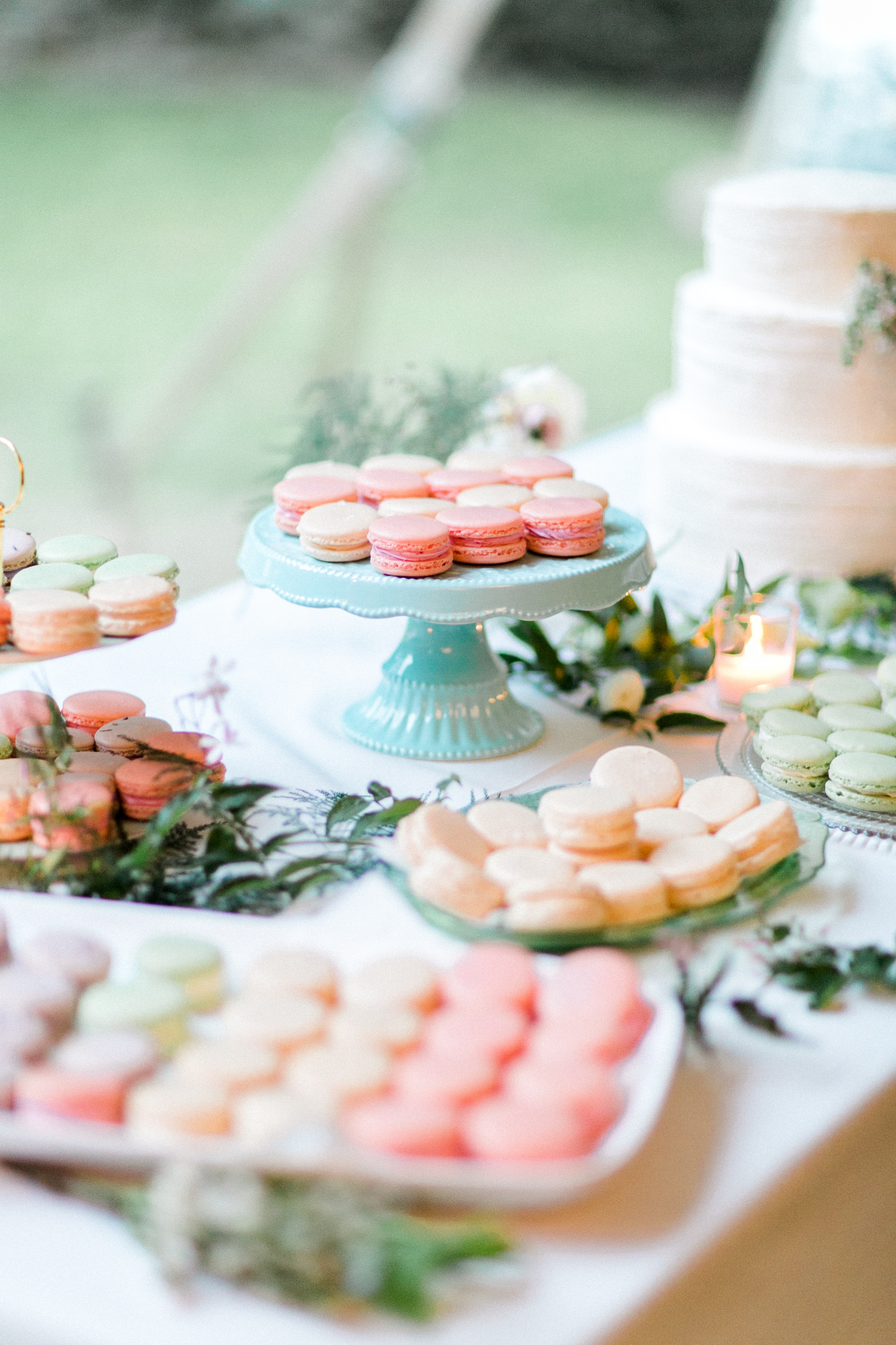 multicolored macarons on a dessert table