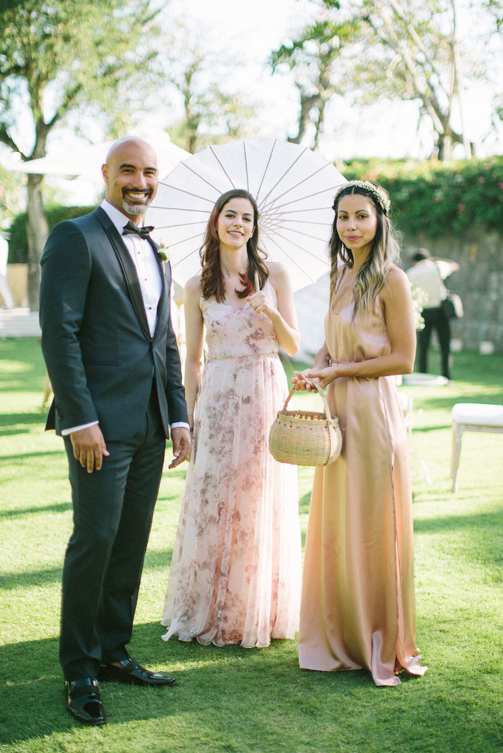 wedding guests outdoors with parasol and wicker basket