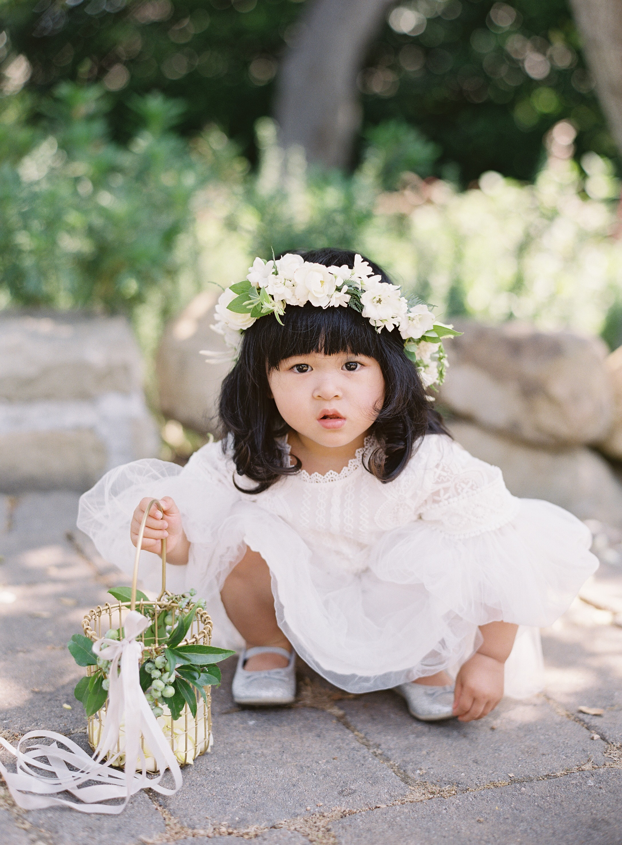 flower girl holding a gold wire basket