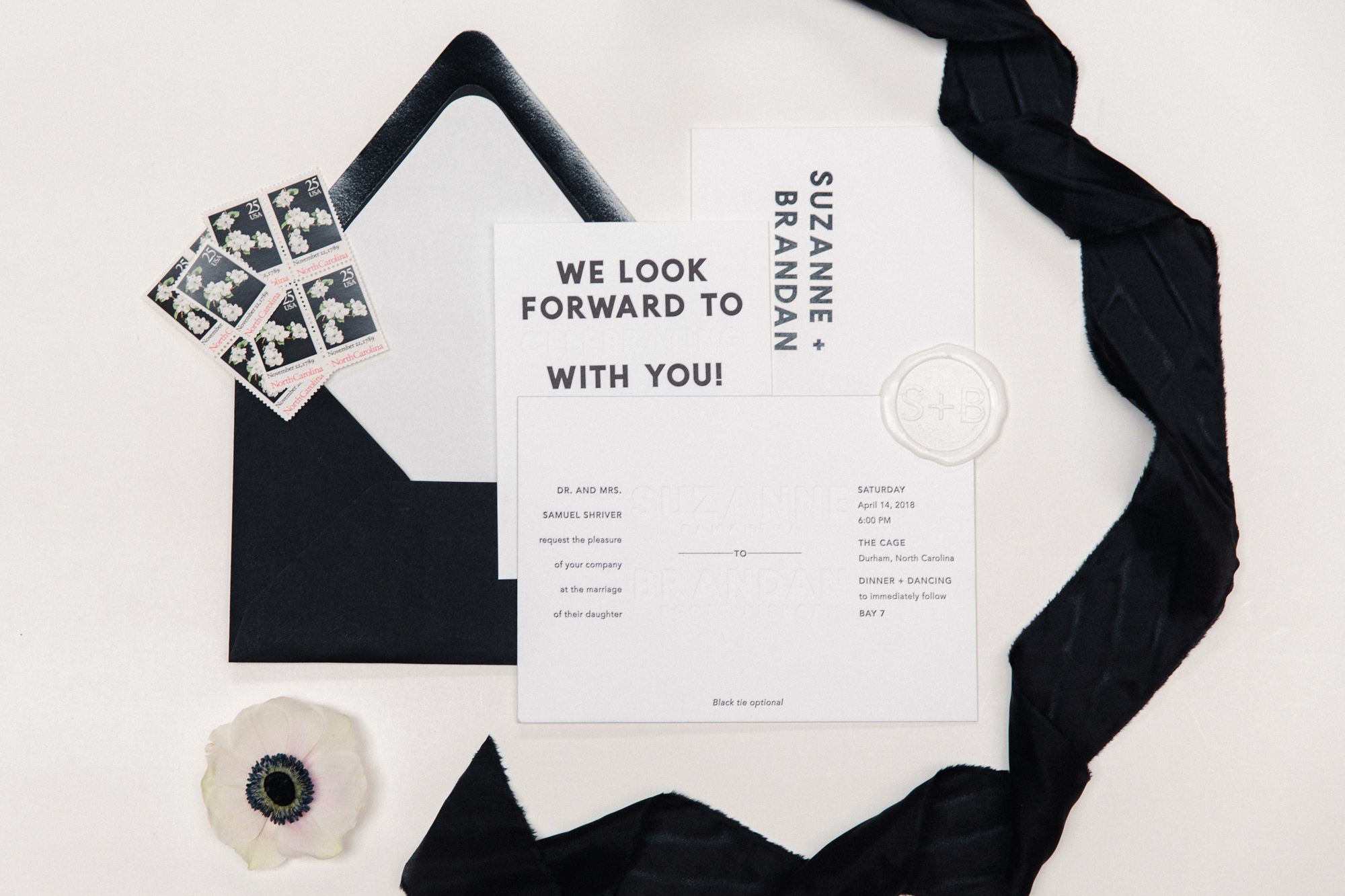 wedding invitations with black envelope and stamps