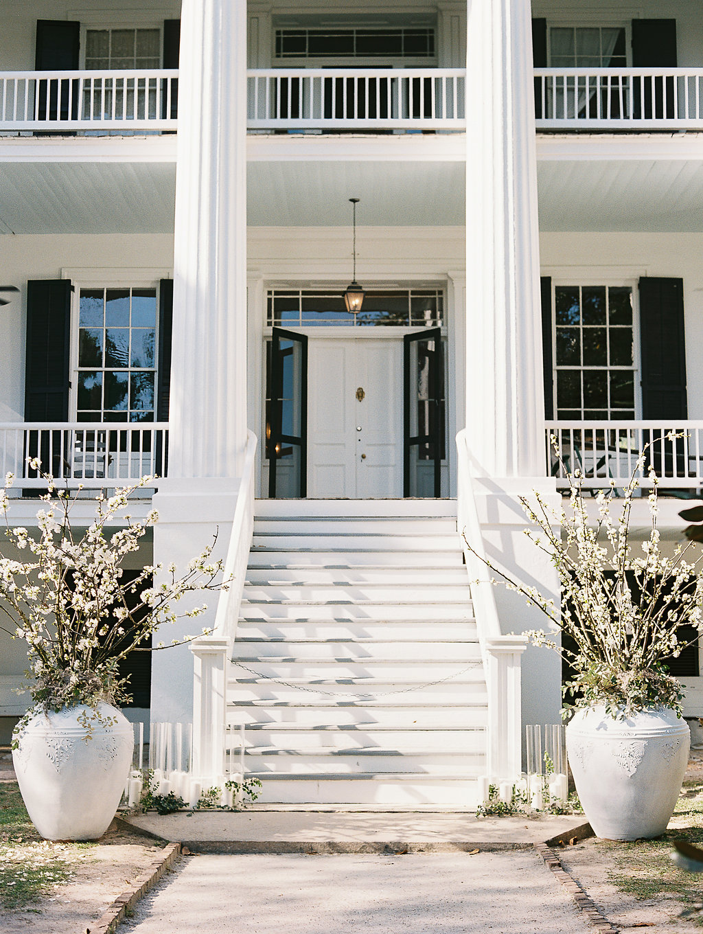 exterior of wedding venue with columns on either side of door