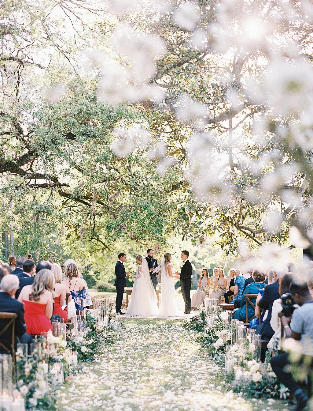 double wedding ceremony beneath oak trees