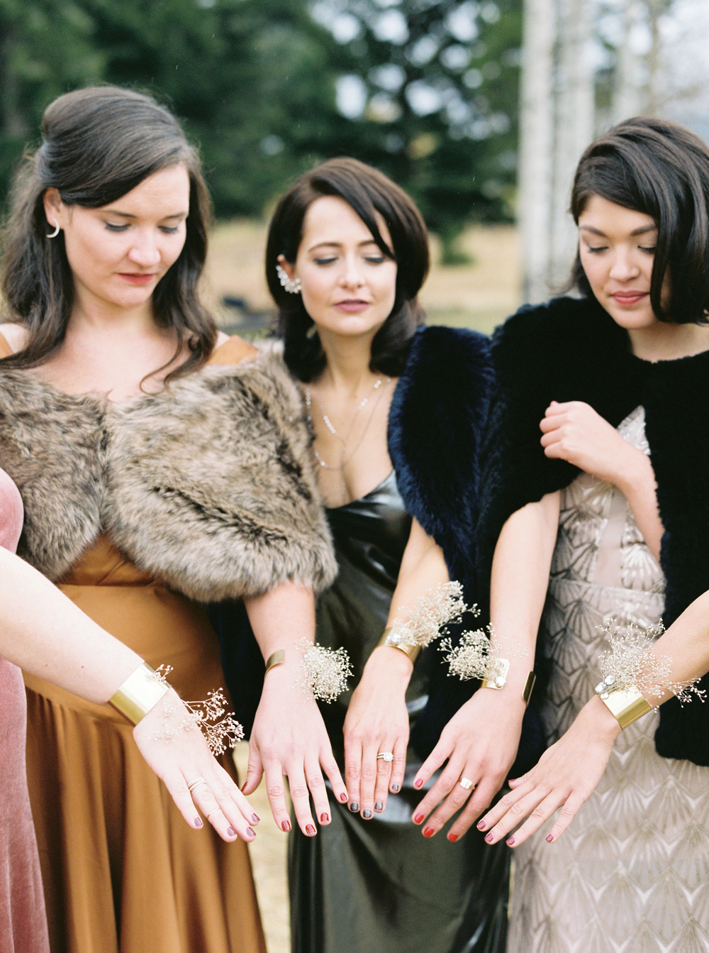 bridesmaids wearing brass cuffs with crystal accents