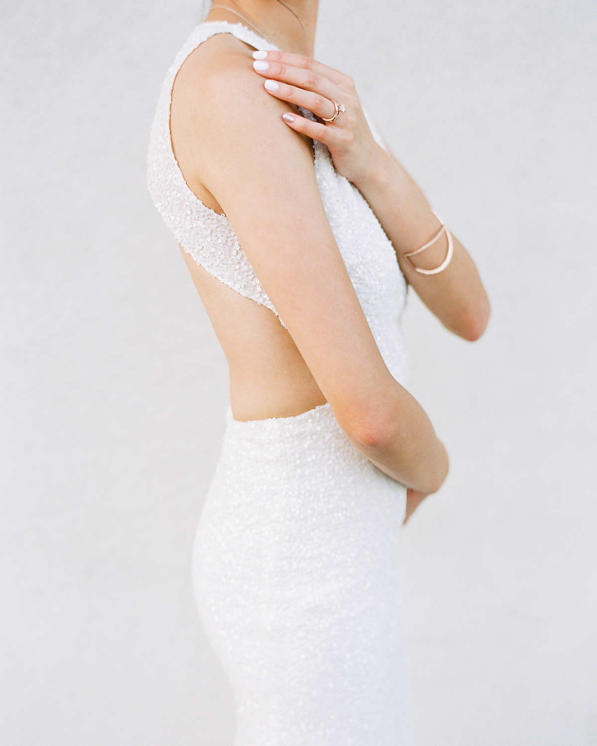 wedding bride in dress showing nails