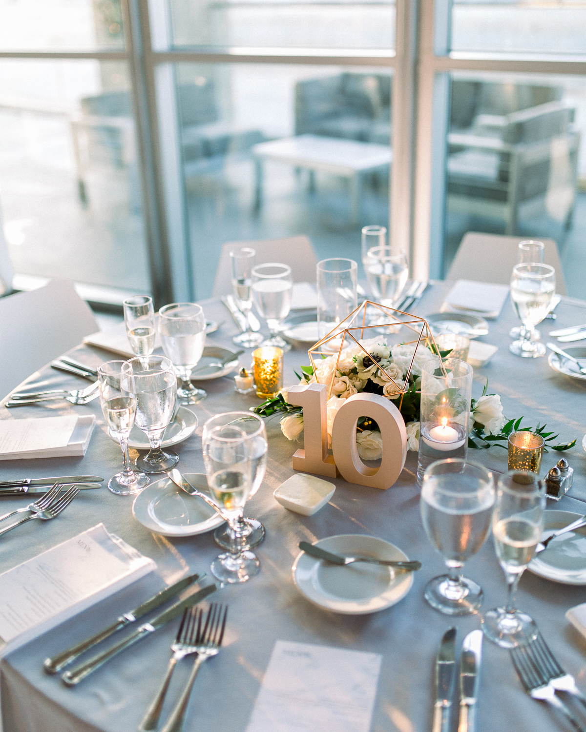 wedding table setting with number ten table number centerpiece