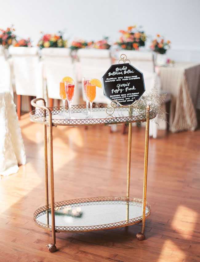 wedding bar cart featuring signature drinks