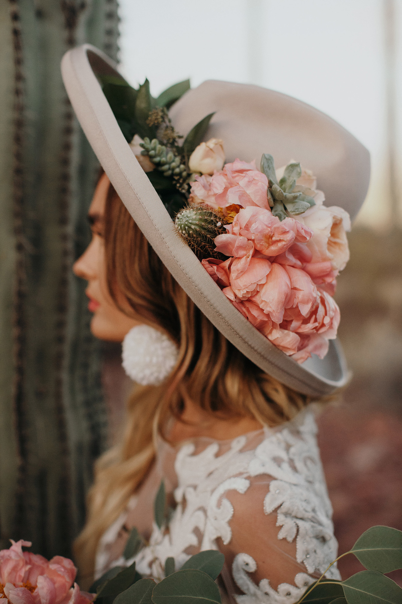 bride wearing brown hat with florals