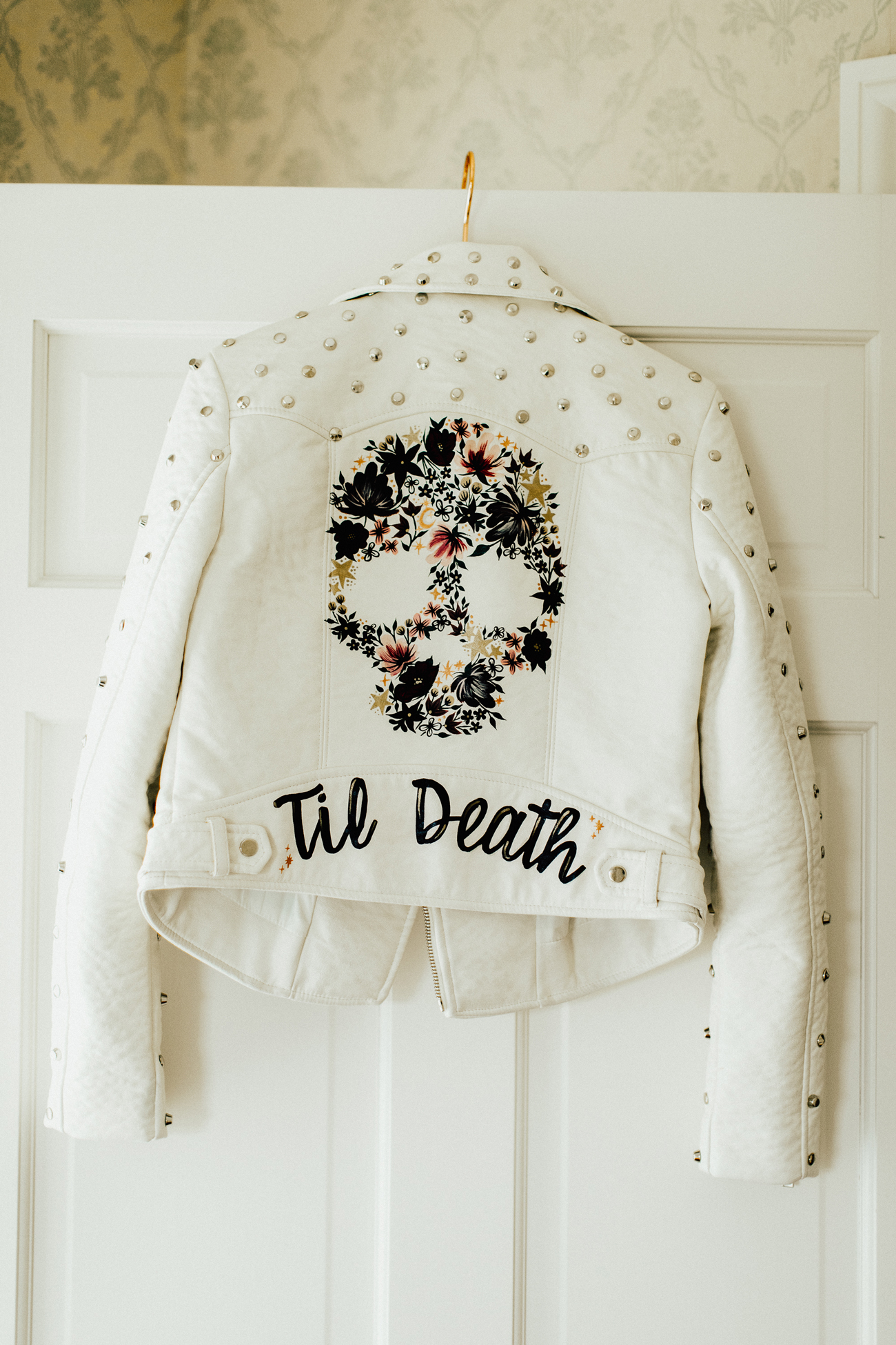 white leather studded jacket with floral skull custom painted