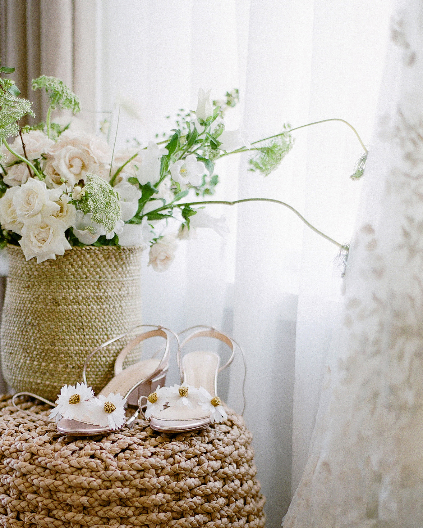 alex drew california wedding shoes and flower arrangement
