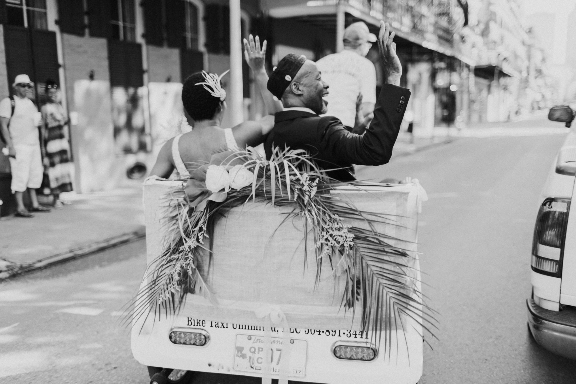 bride and father riding in bike taxi