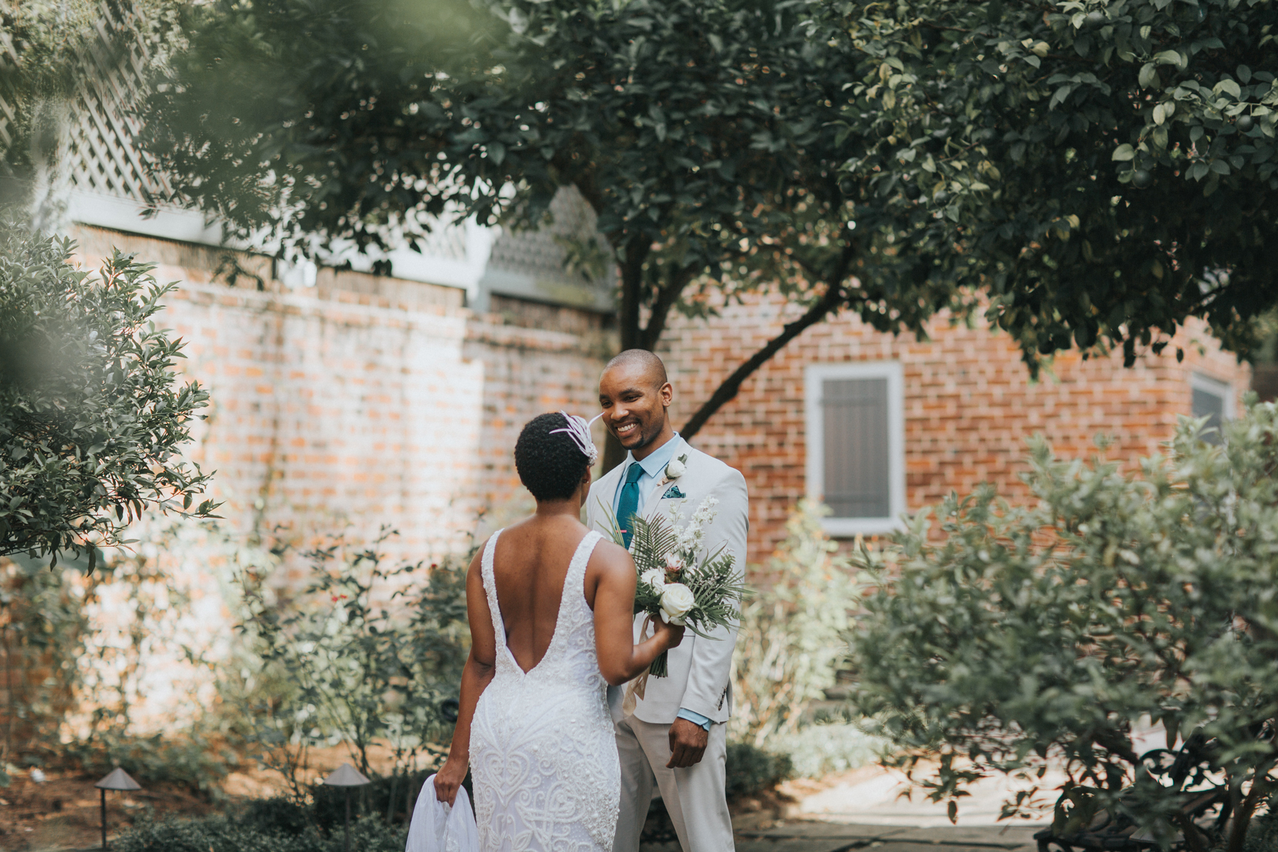 bride and groom sharing first look in courtyard