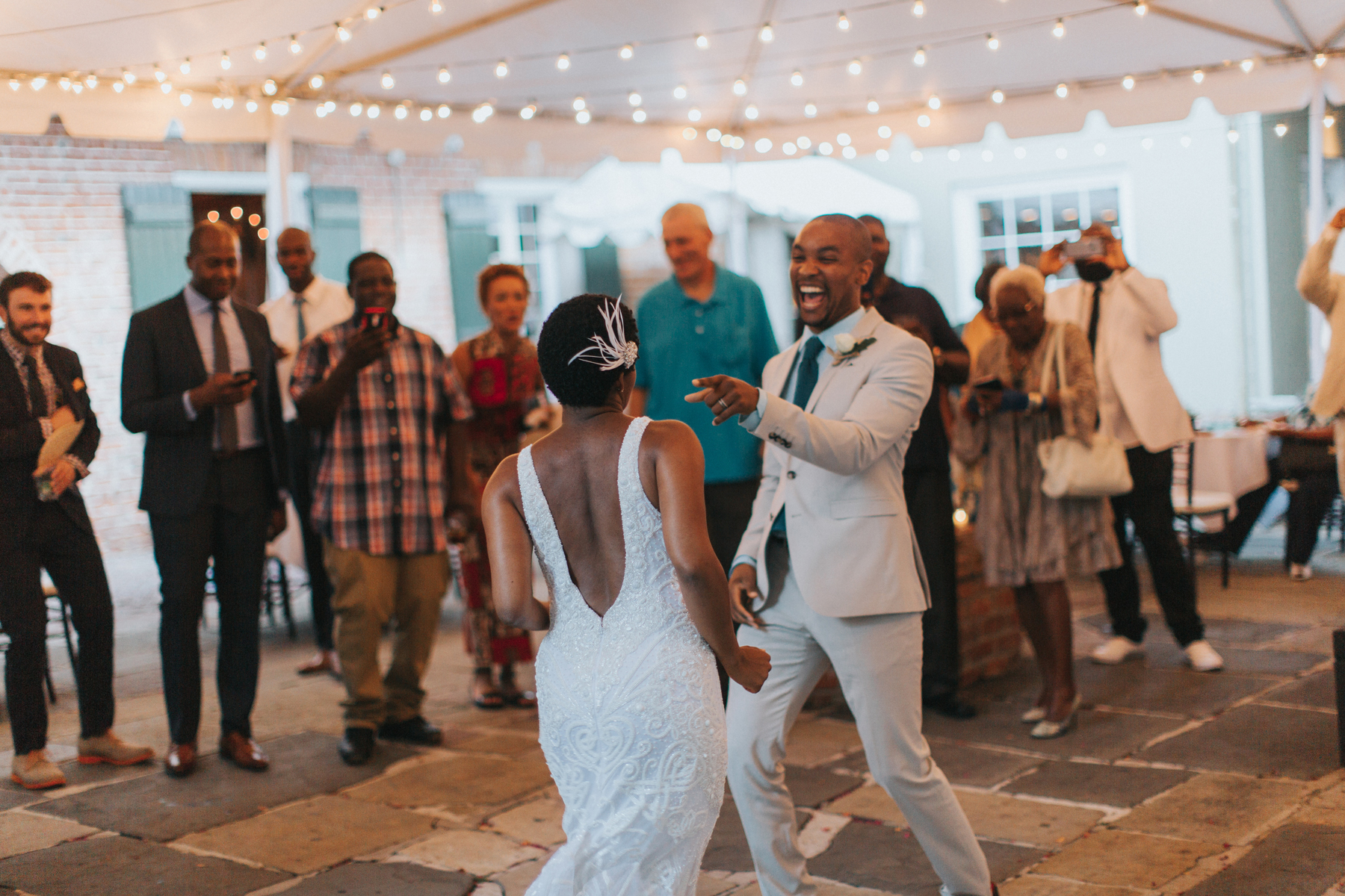 bride and groom laughing sharing first dance