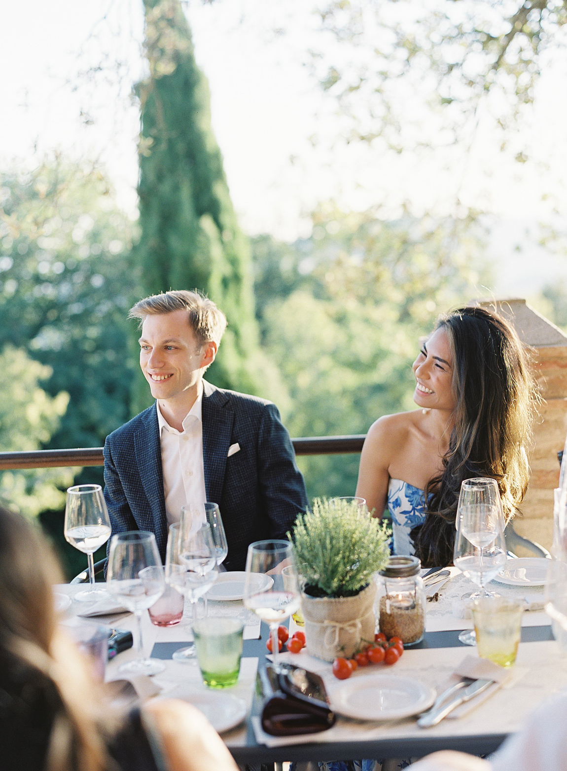 bride and groom during rehearsal dinner on patio