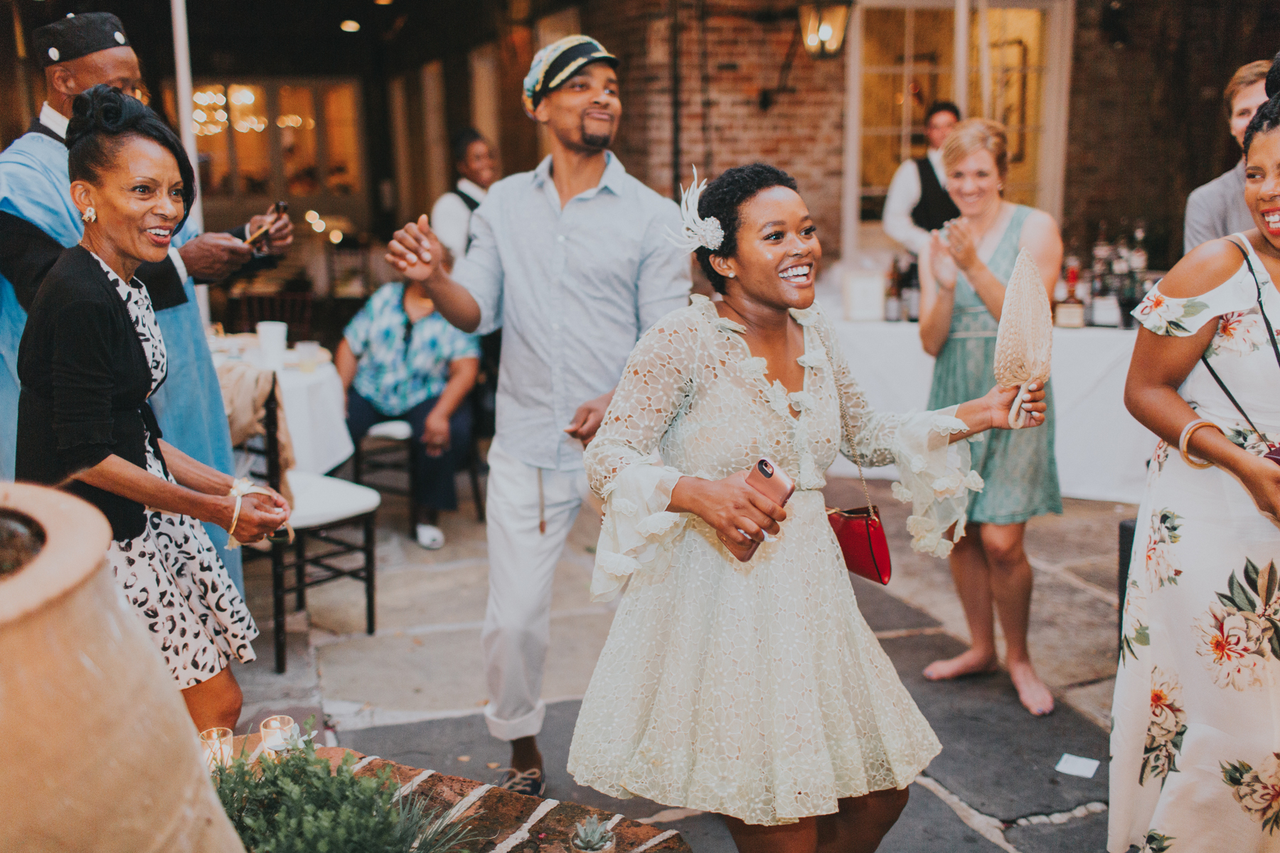 bride and groom dancing with guests at reception