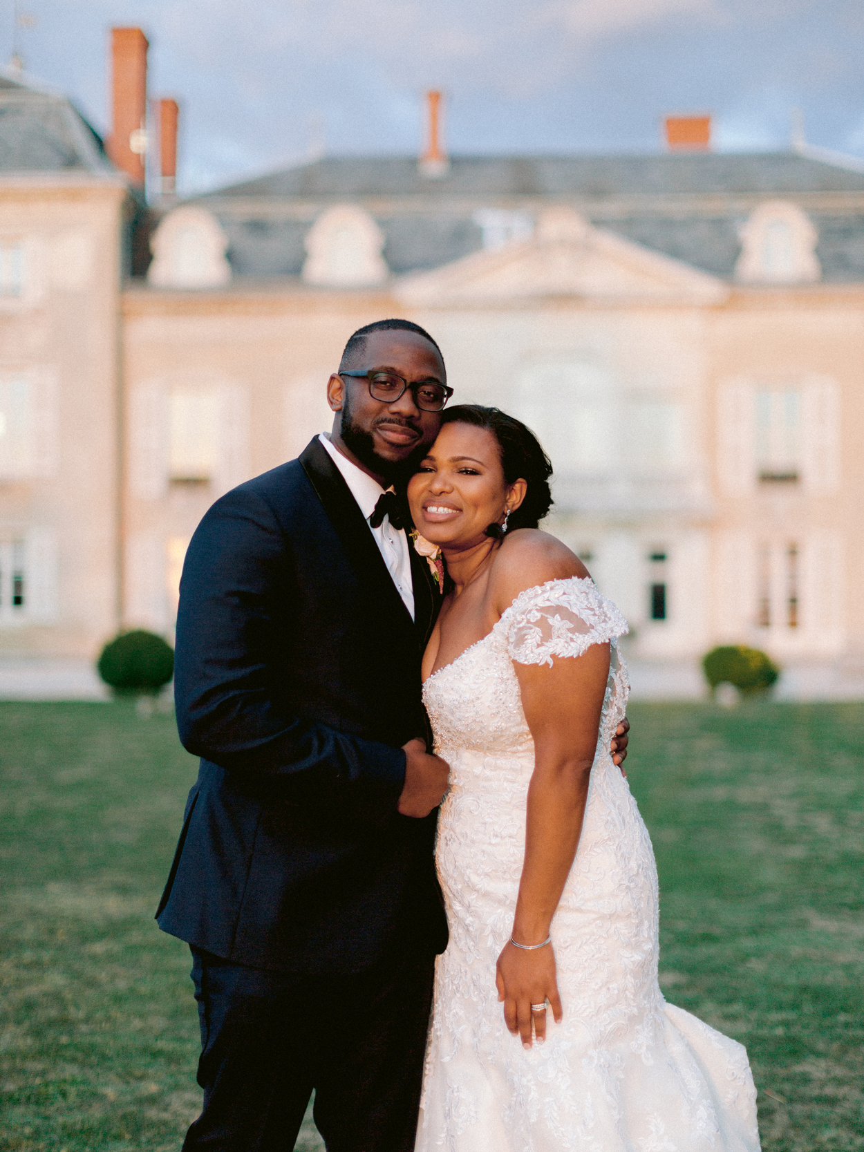bride and groom hold each other during portrait photo