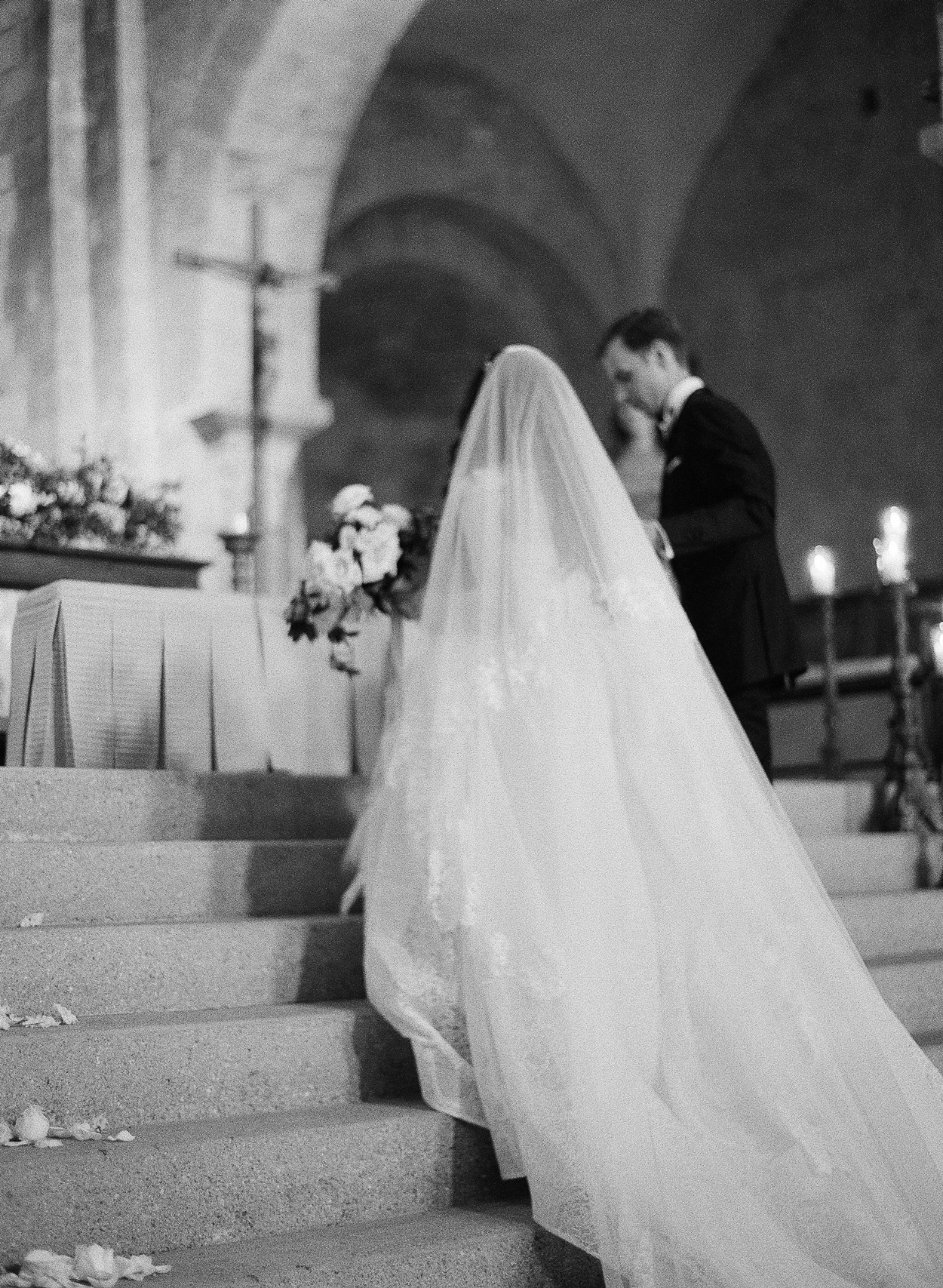 bride and groom at catholic ceremony wedding alter