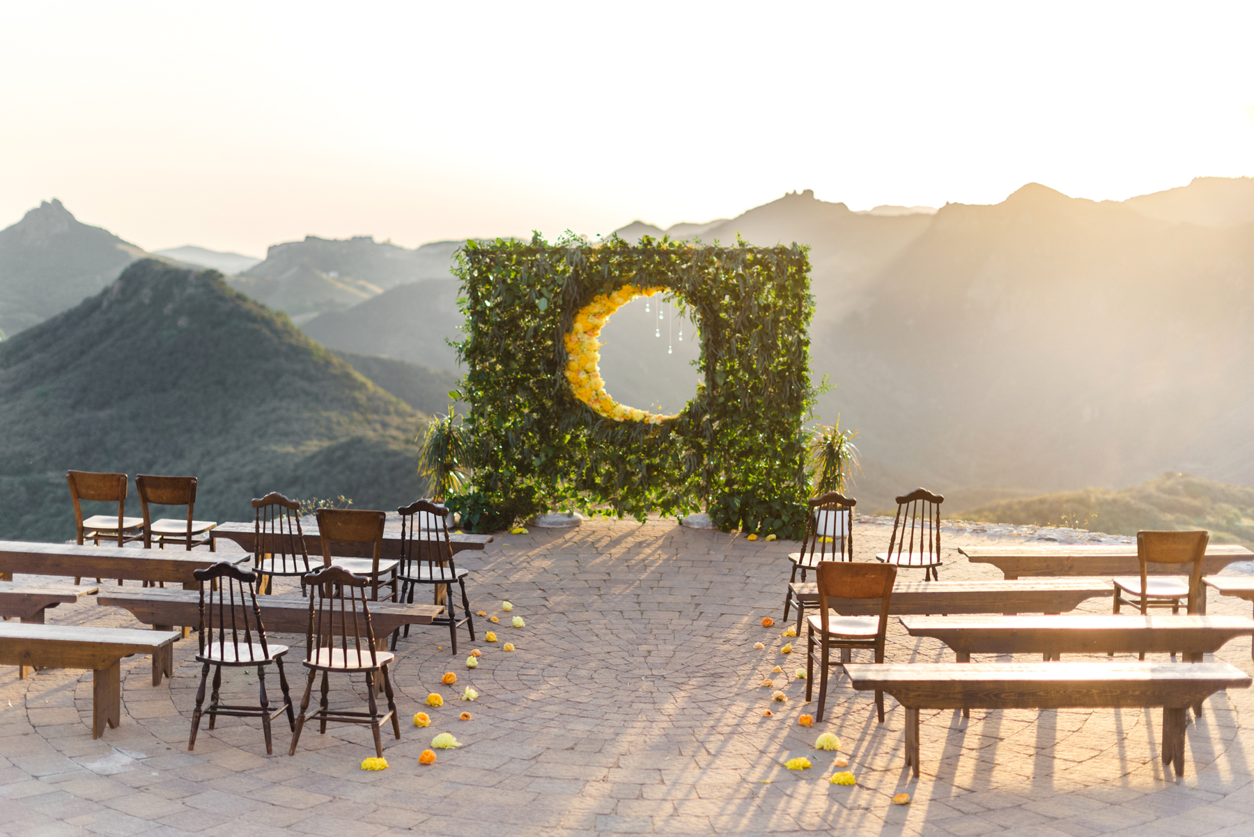 wedding plant wall greenery with circular cutout showcasing mountain range