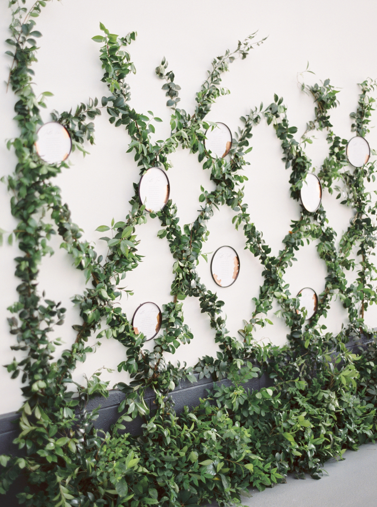 wedding plant wall criss-crossed green garland