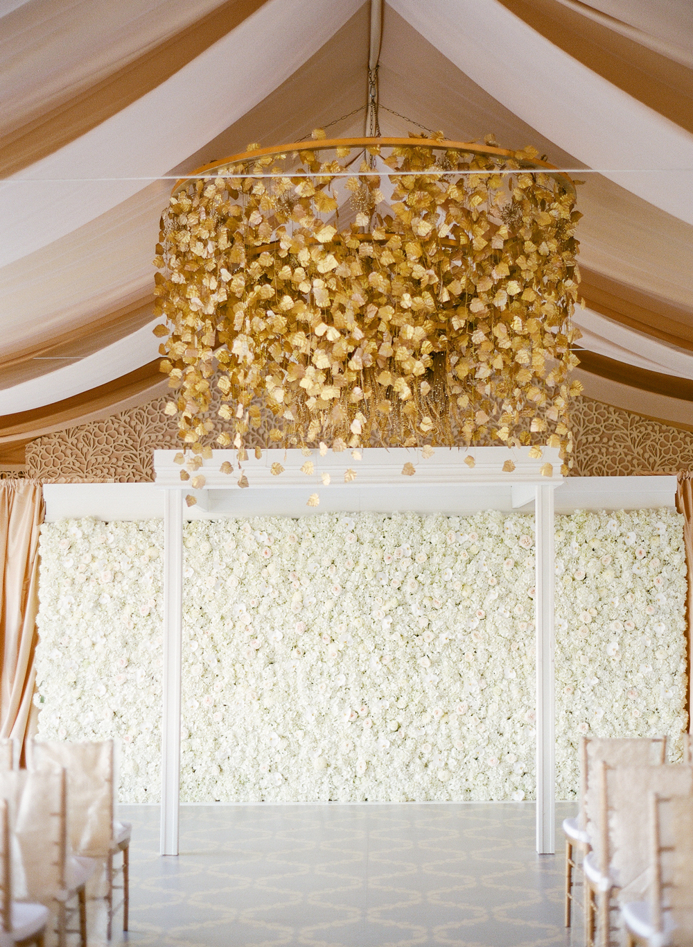 wedding plant wall white roses and gold leaf chandelier