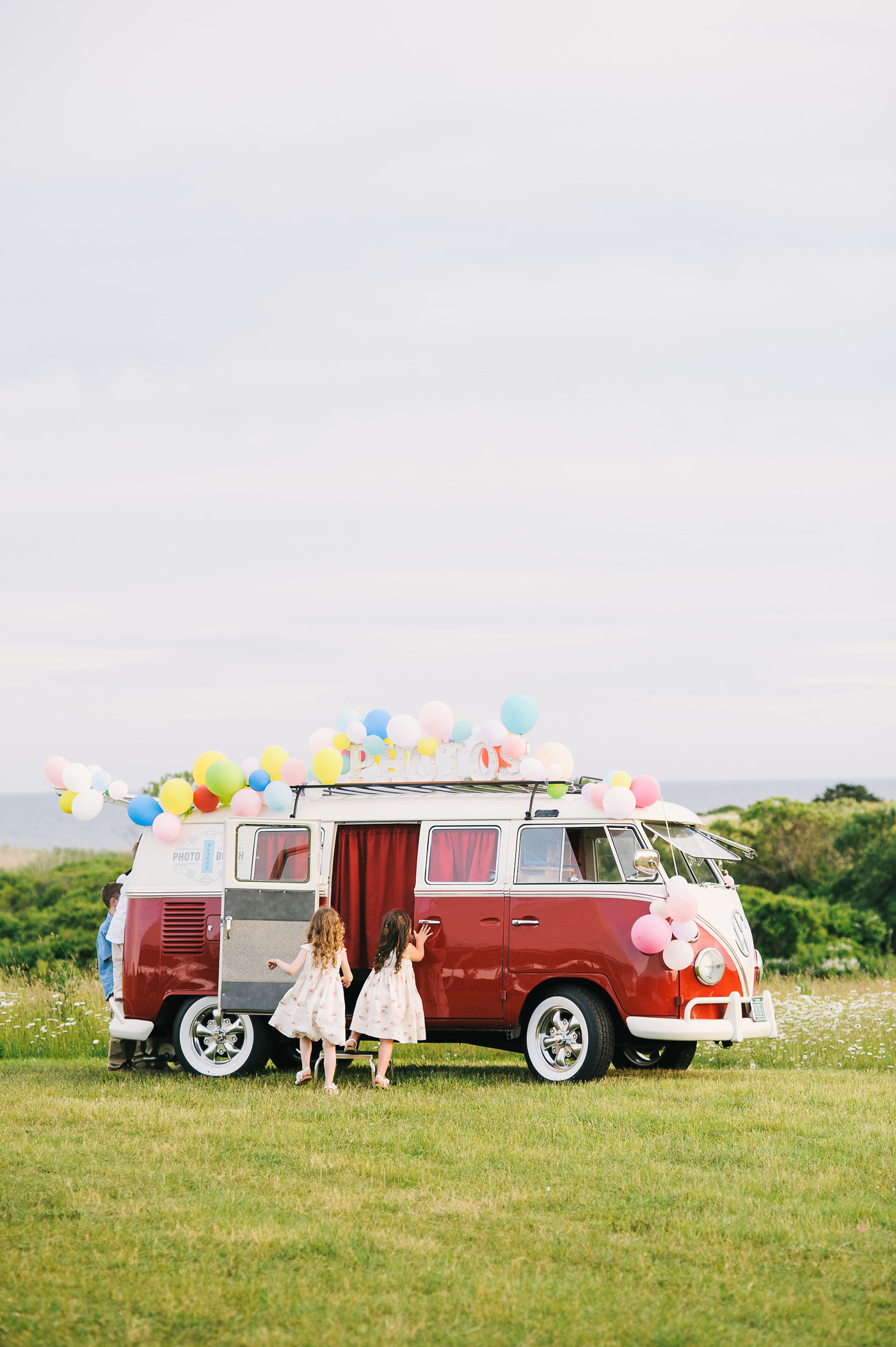 red van covered in balloons for photo booth area
