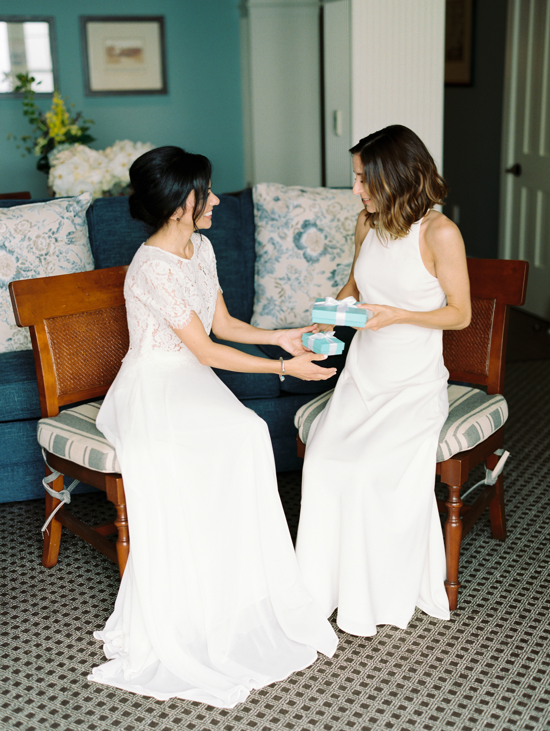 brides exchanging Tiffany Co. wedding gifts