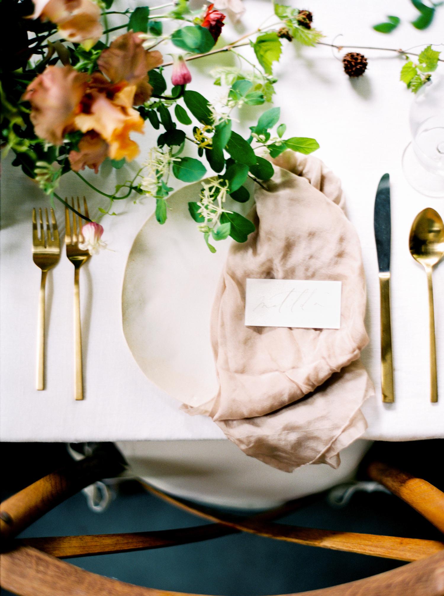 wedding reception napkin folds pink napkin draped on one half of plate