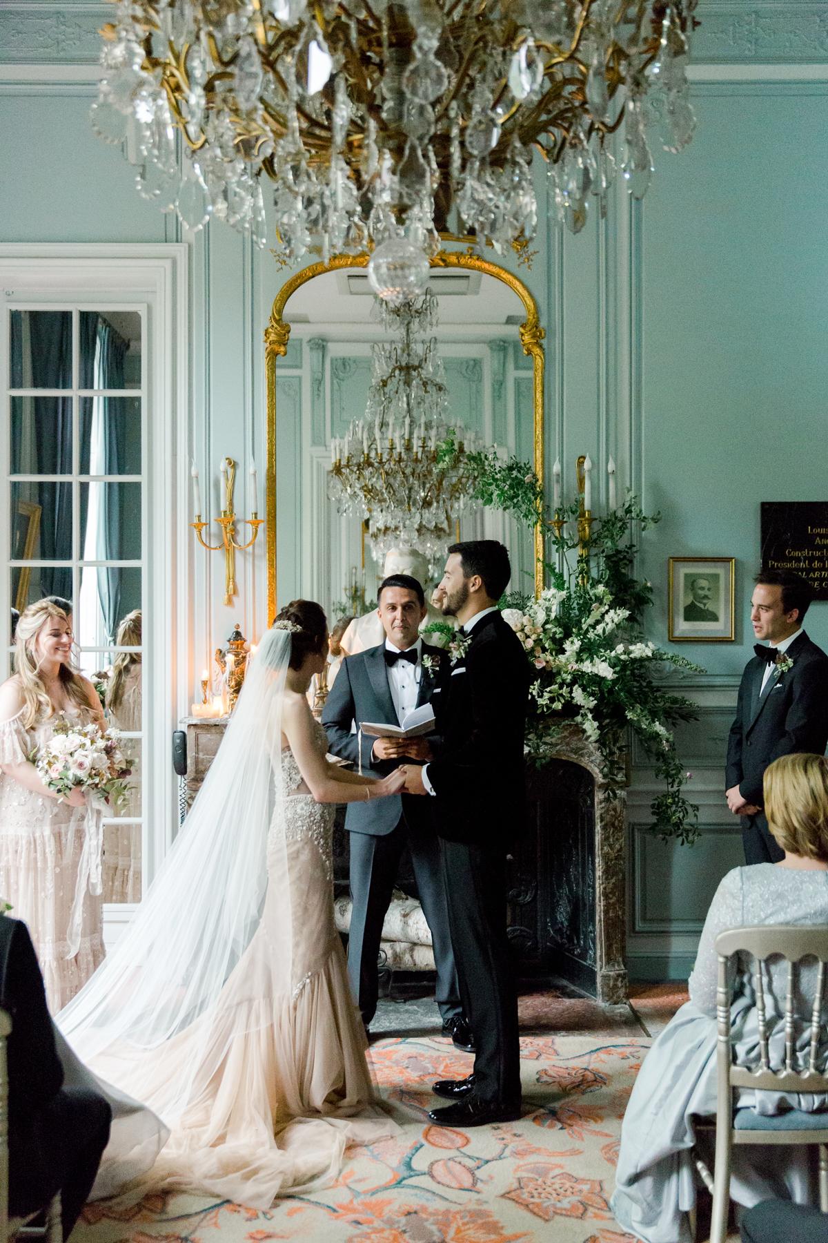 wedding ceremony in ornate parisian salon