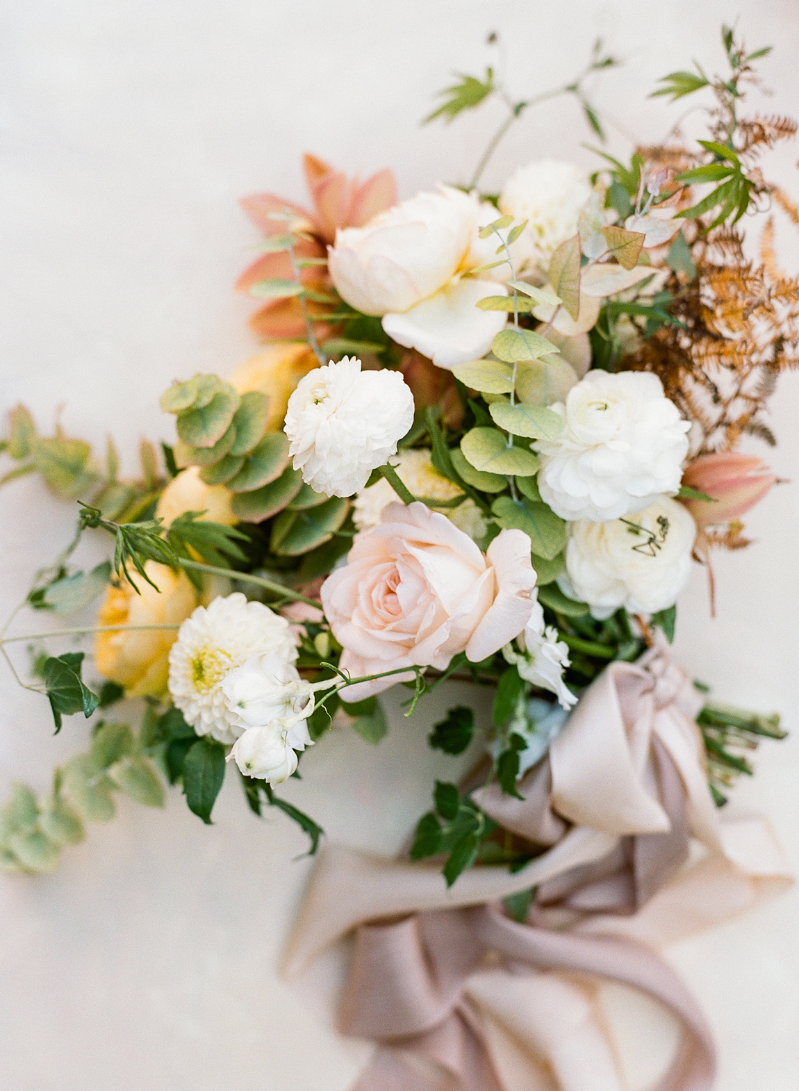 citrus colored floral and greenery bouquet