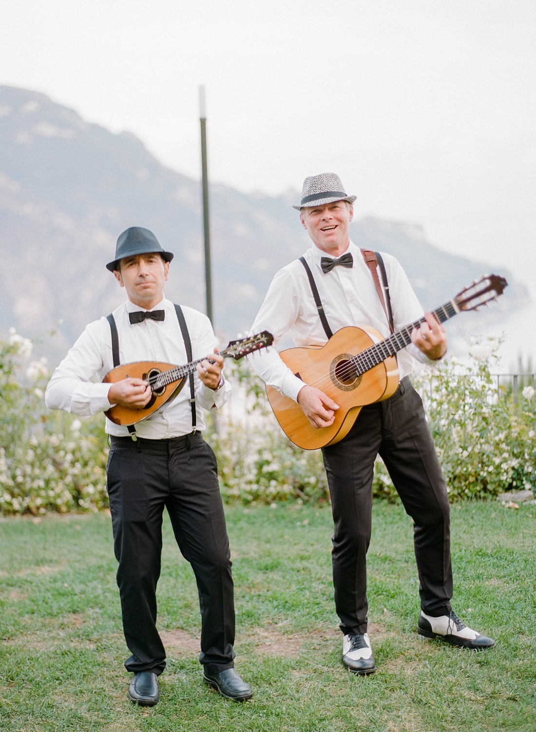Italian musicians wearing bowties and suspenders