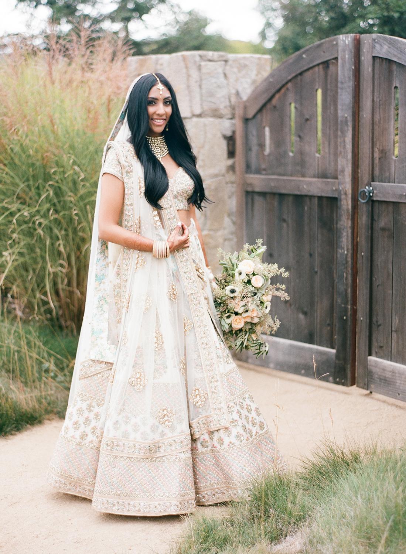 Indian designer made traditional Indian wedding bride attire