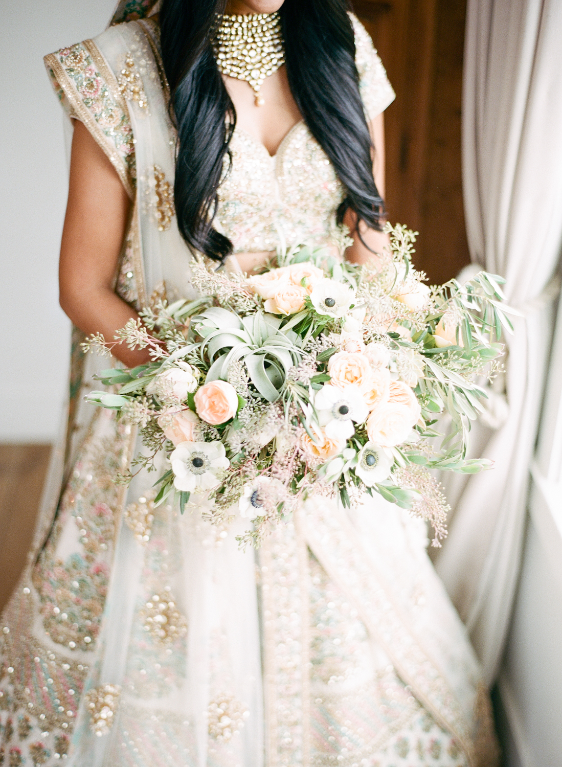 white, blush, and peach blooms with greenery accents and silk ribbon finish