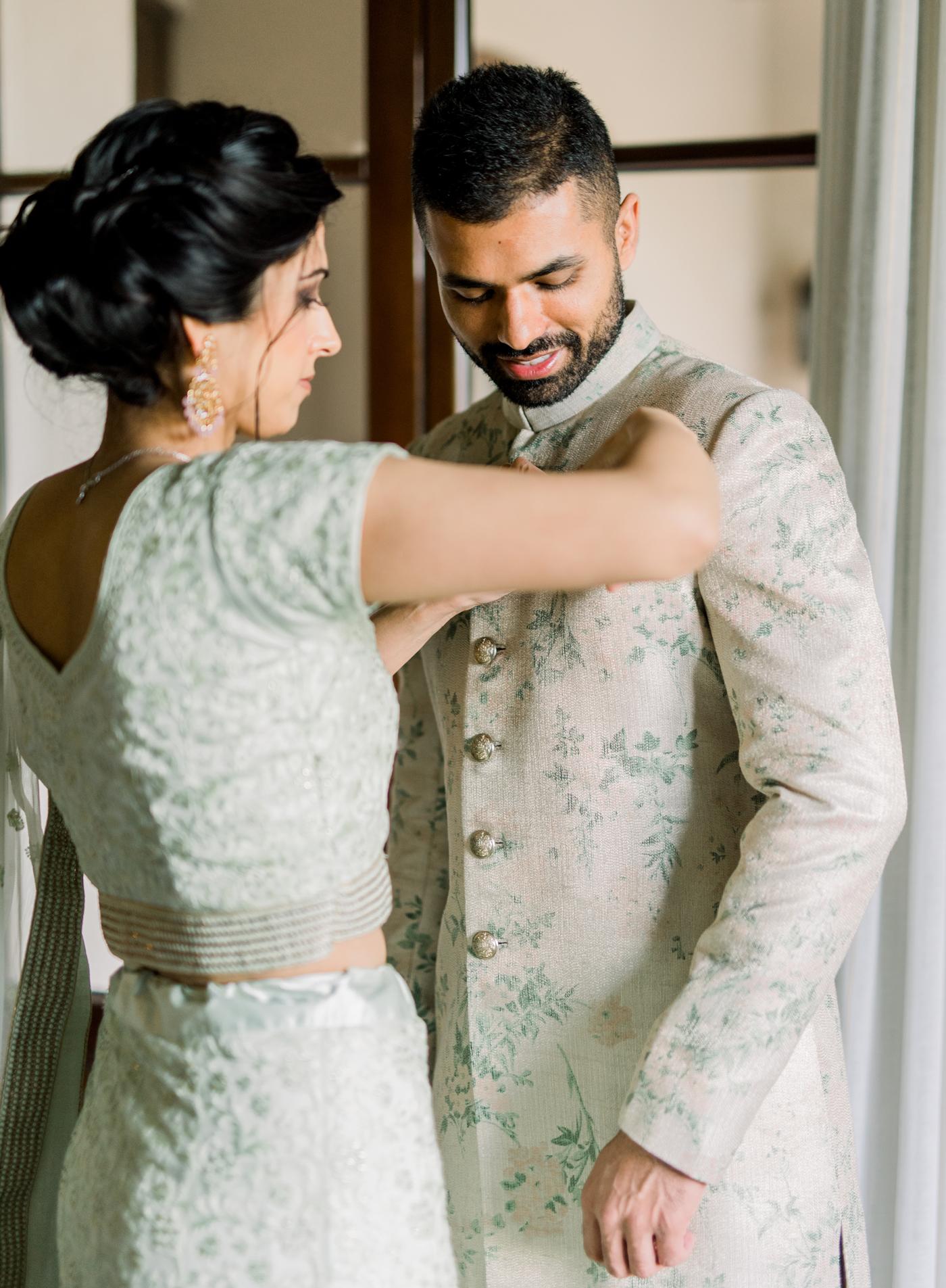 groom getting ready before wedding ceremony