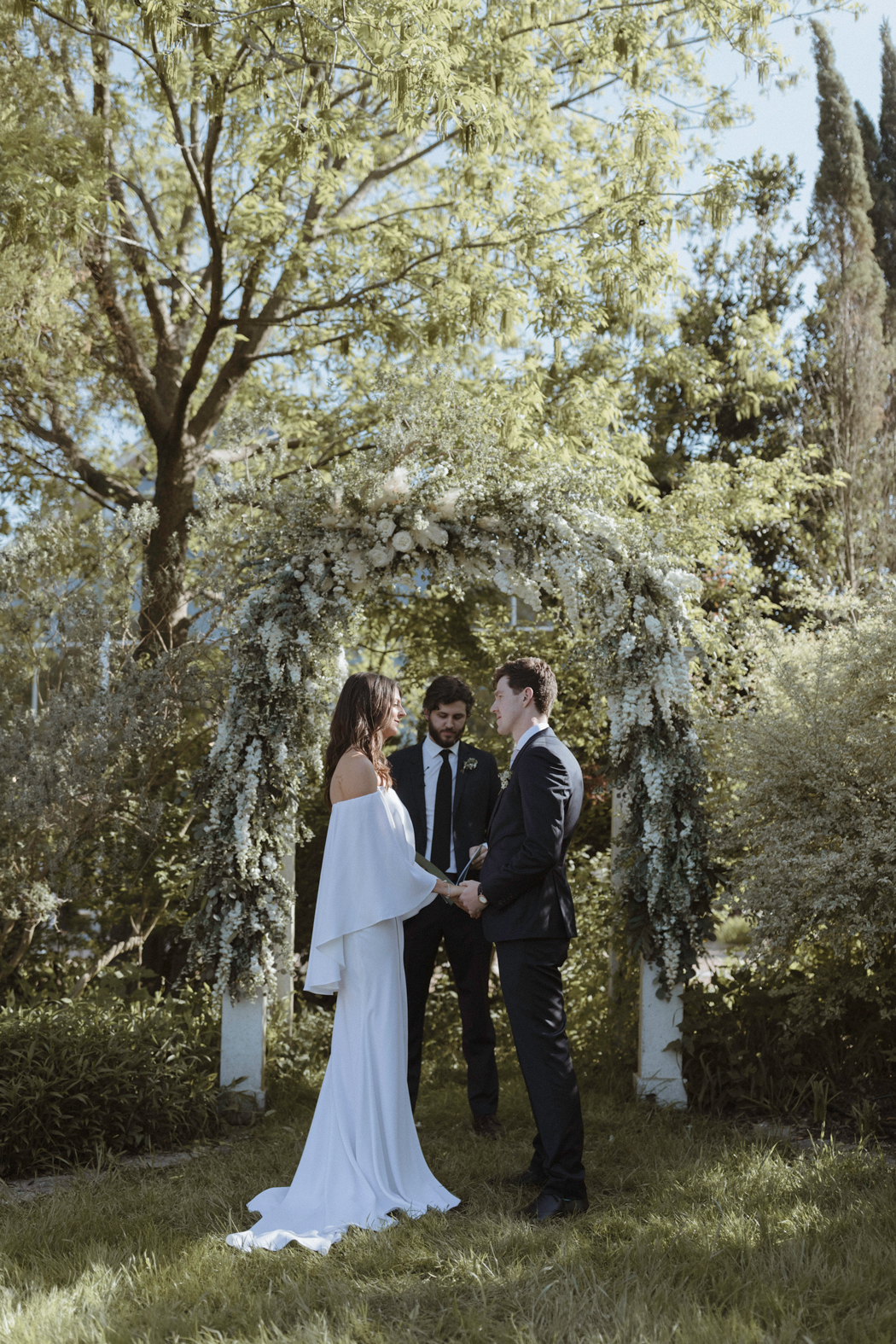 flower arch wedding ceremony in garden