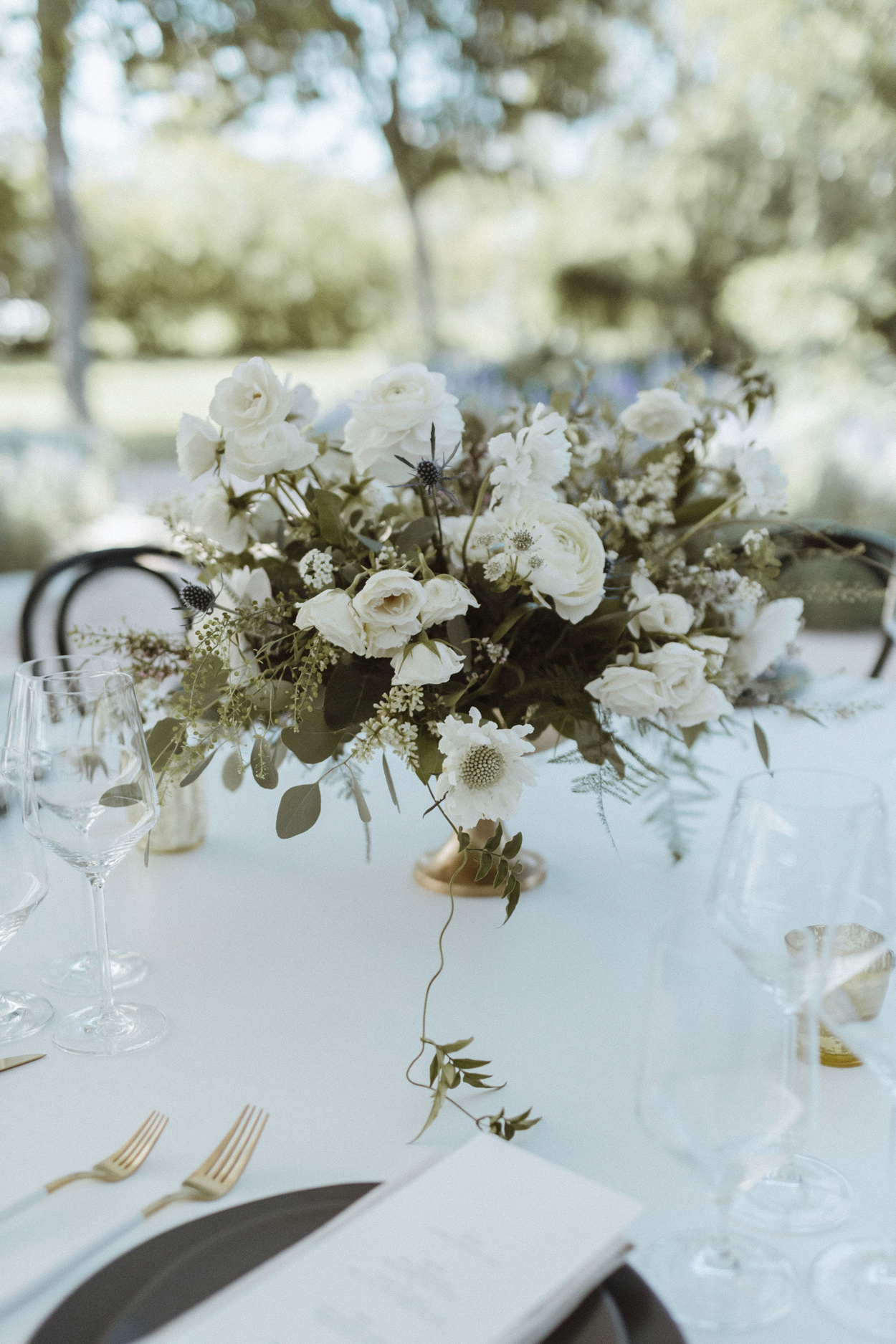 white and green muted blooms centerpieces