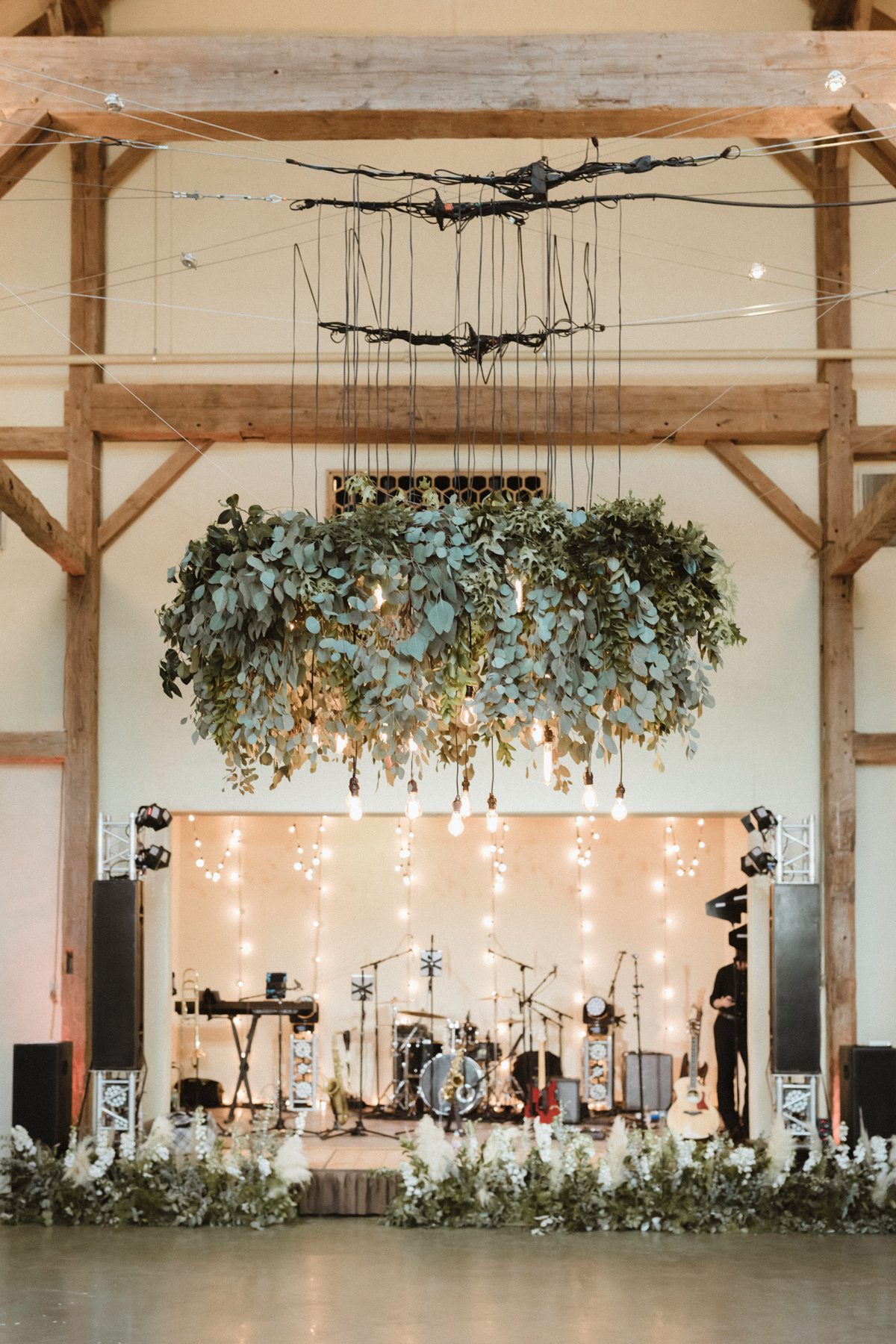 large hanging greenery display over dance floor