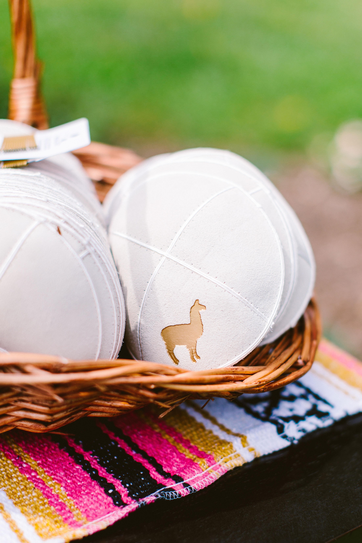 gold llama emblazoning white yarmulke