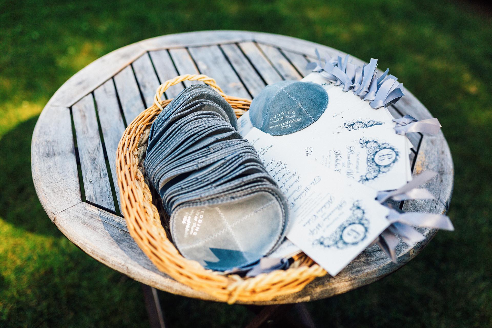 blue yarmulkes matching programs on wood table